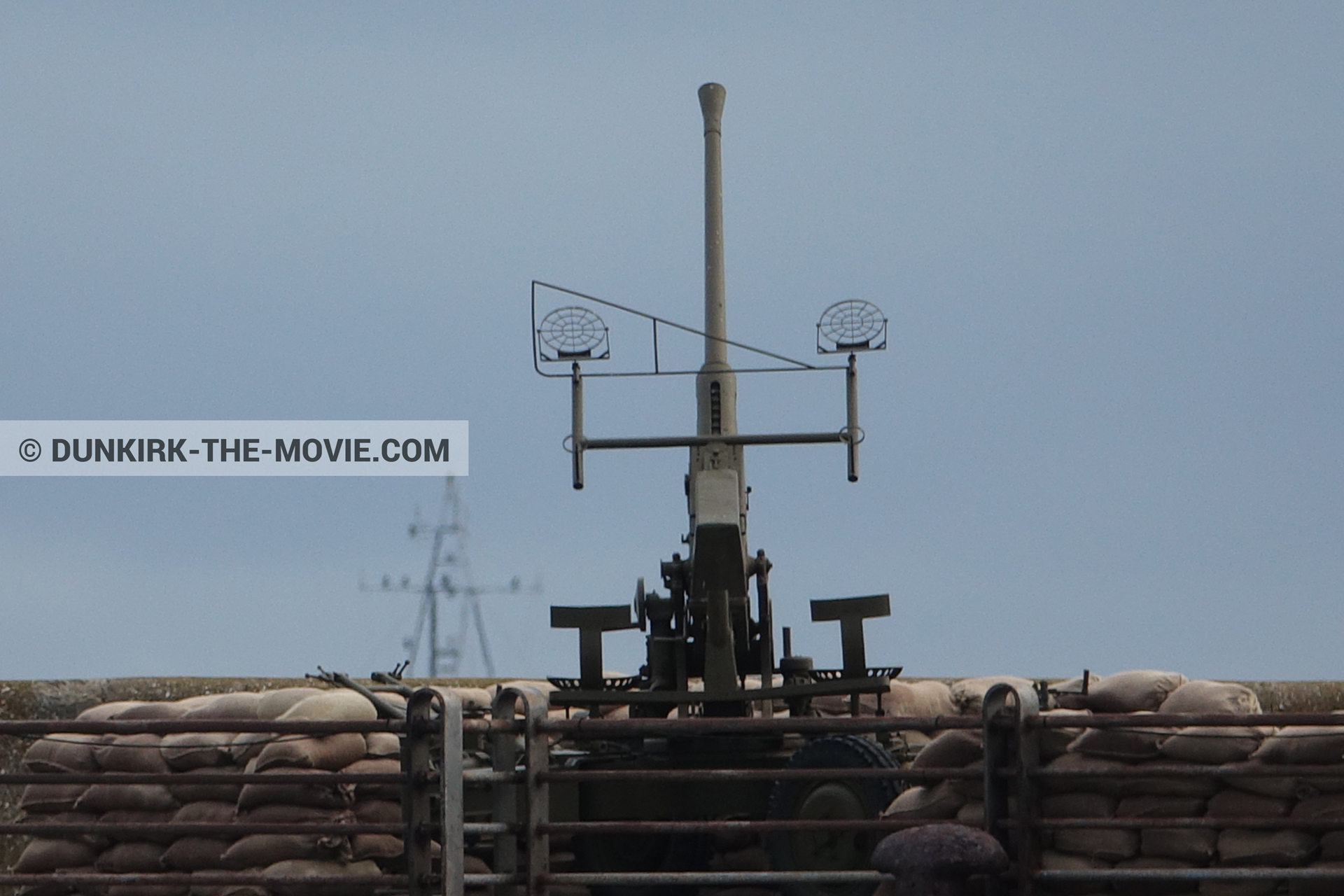 Picture with cannon, blue sky, EST pier,  from behind the scene of the Dunkirk movie by Nolan