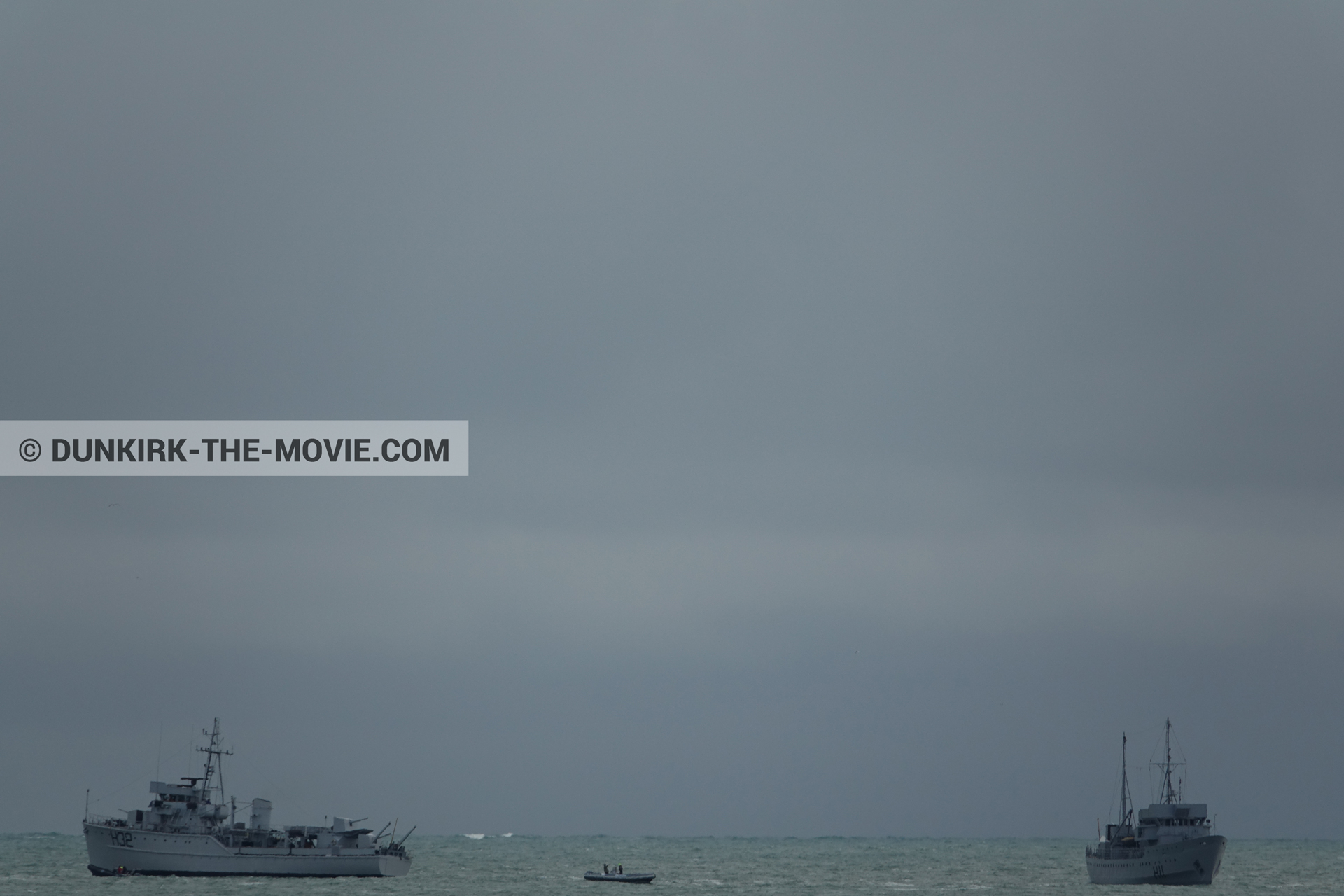 Picture with boat, grey sky,  from behind the scene of the Dunkirk movie by Nolan