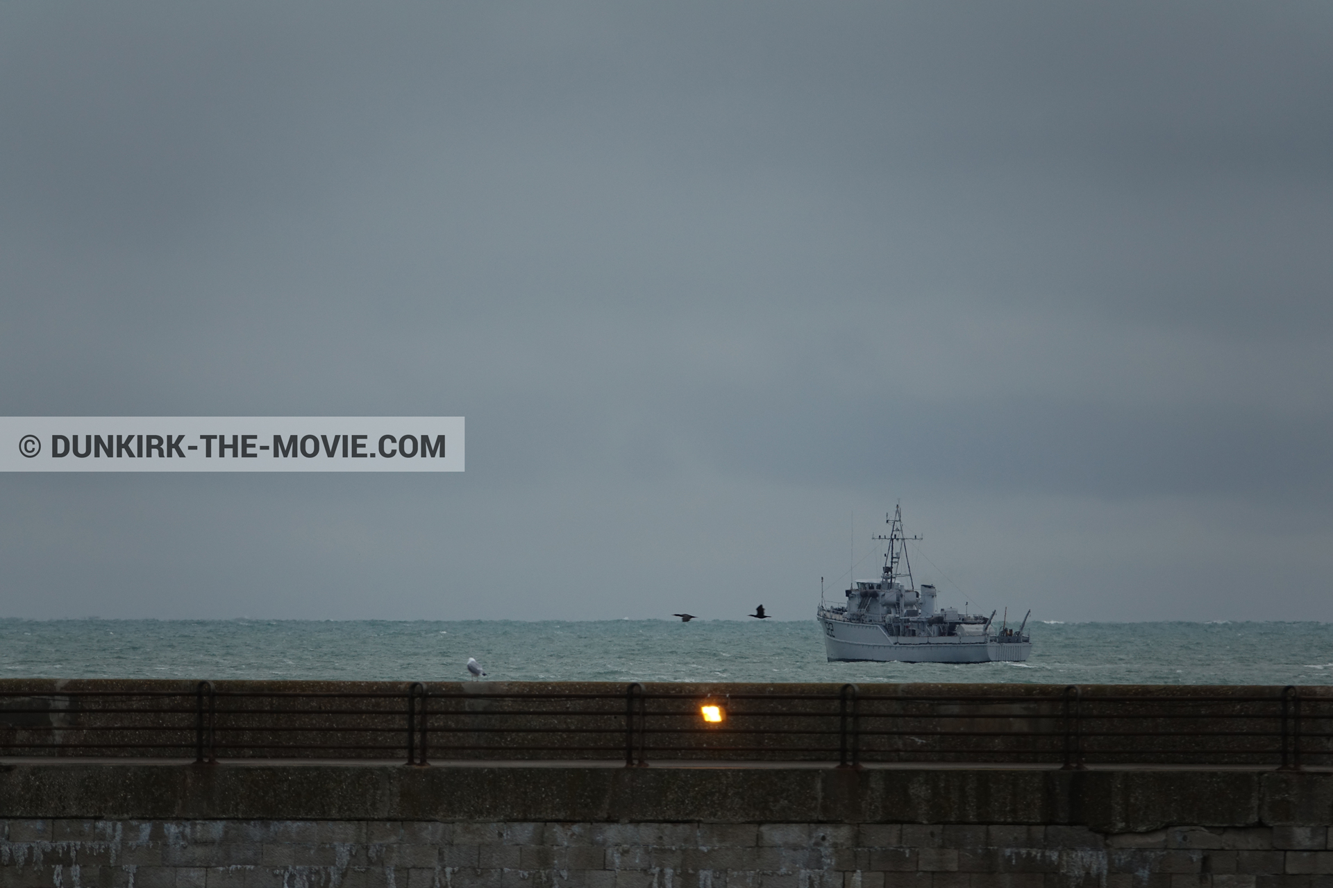 Picture with boat, grey sky, EST pier,  from behind the scene of the Dunkirk movie by Nolan