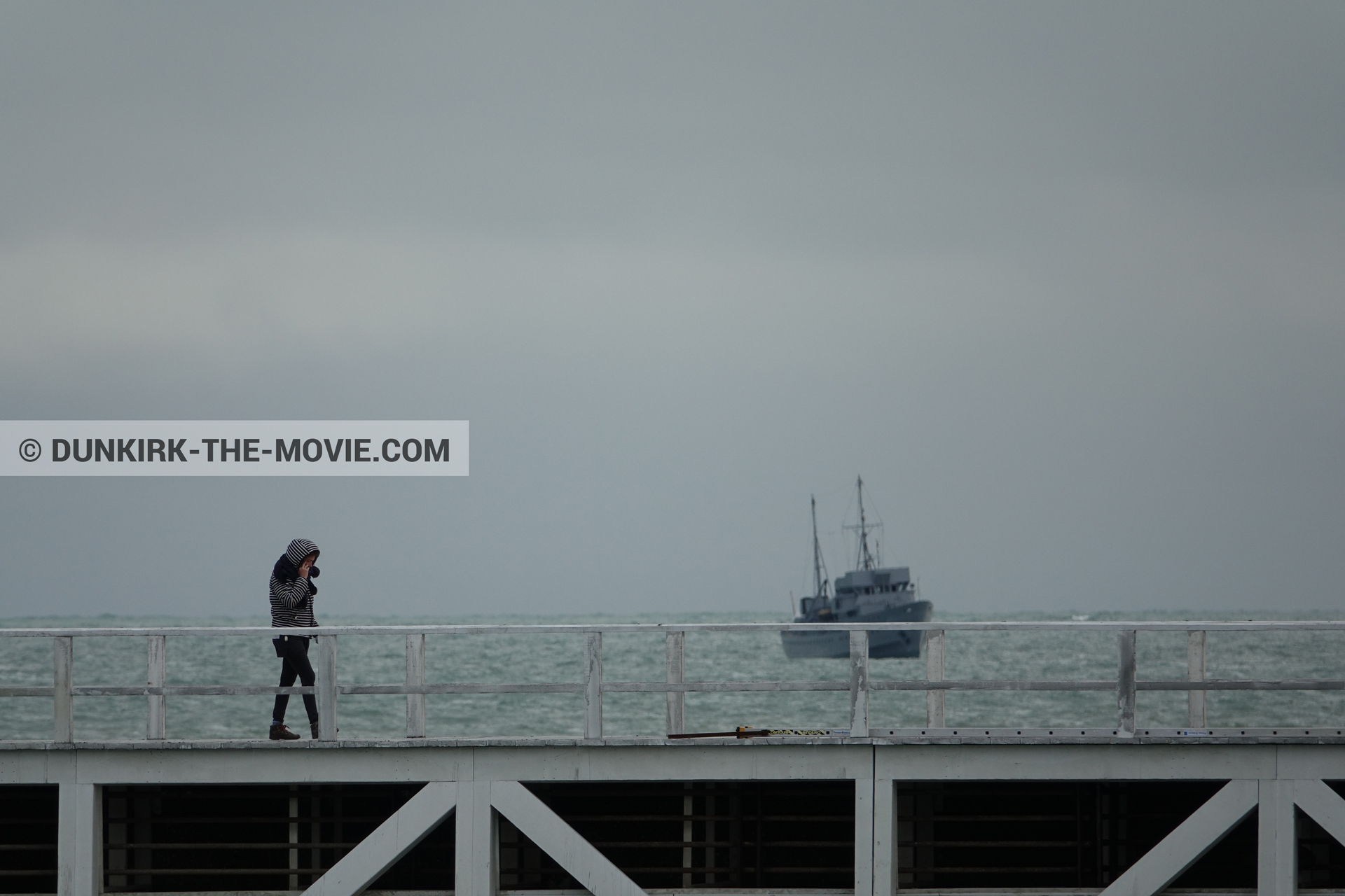 Picture with boat, grey sky, EST pier, technical team,  from behind the scene of the Dunkirk movie by Nolan
