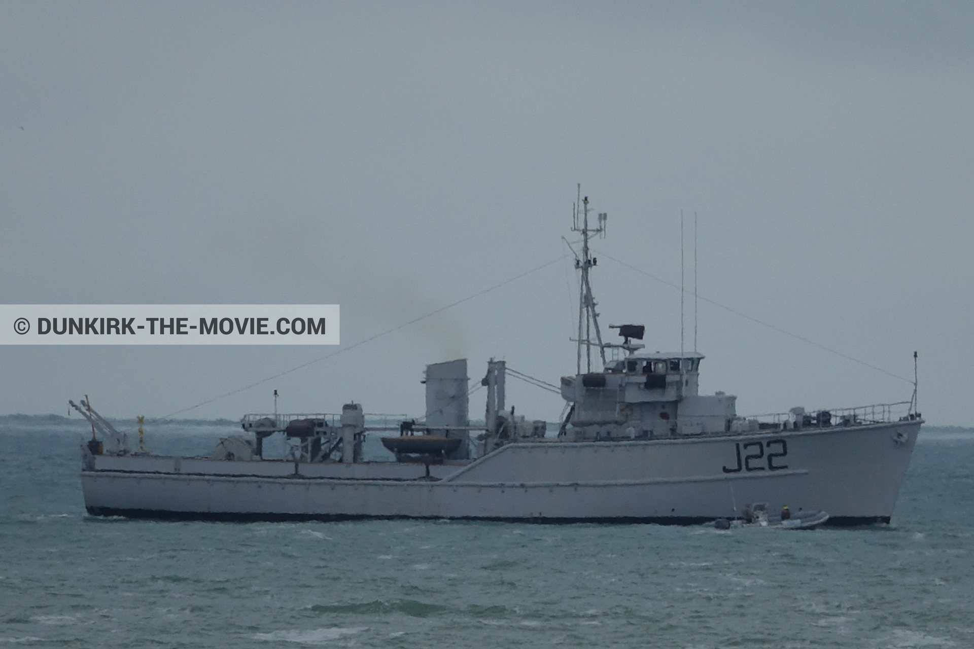 Picture with boat, grey sky, J22 -Hr.Ms. Naaldwijk, calm sea,  from behind the scene of the Dunkirk movie by Nolan