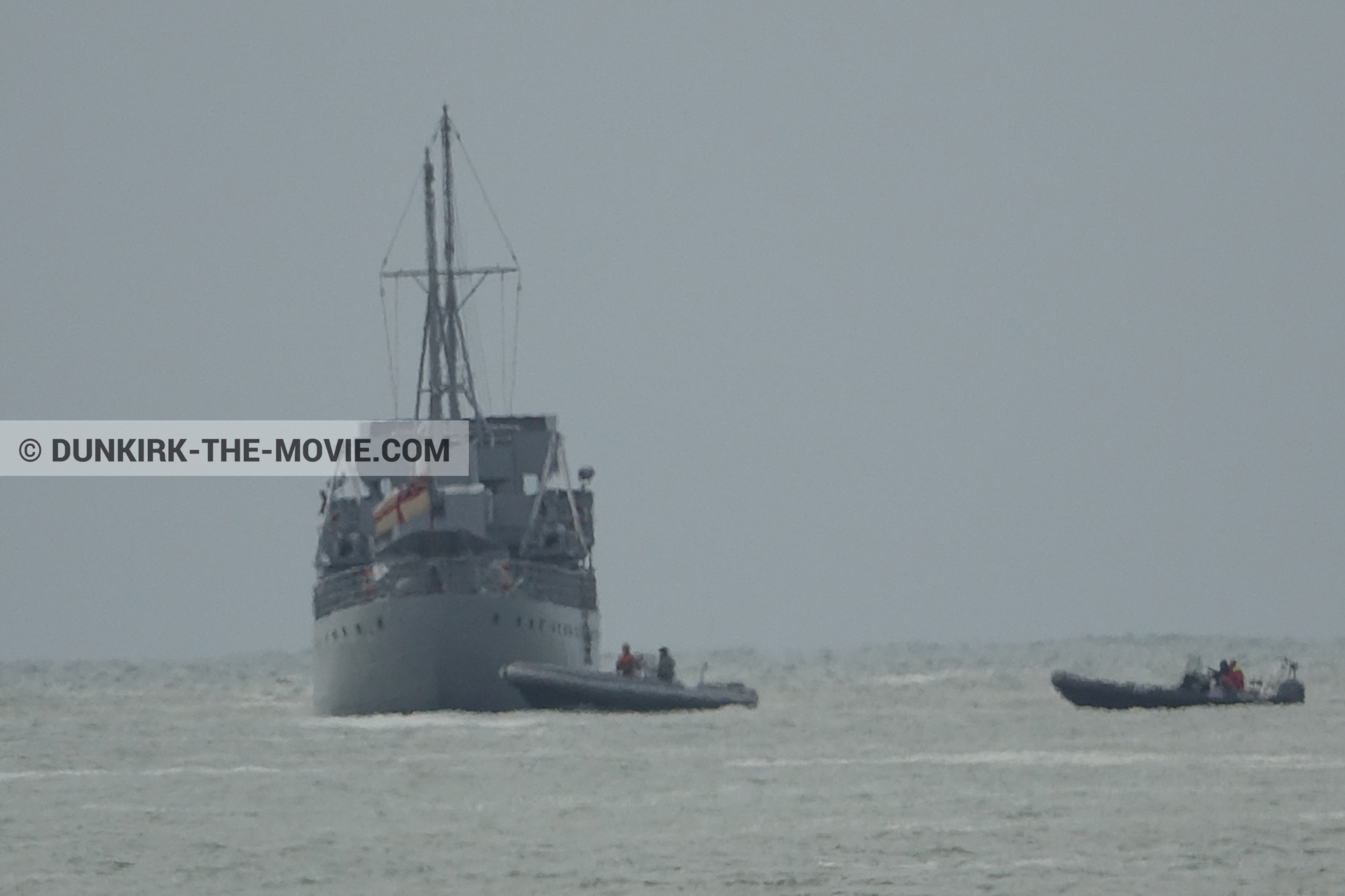 Picture with boat, grey sky, rough sea,  from behind the scene of the Dunkirk movie by Nolan