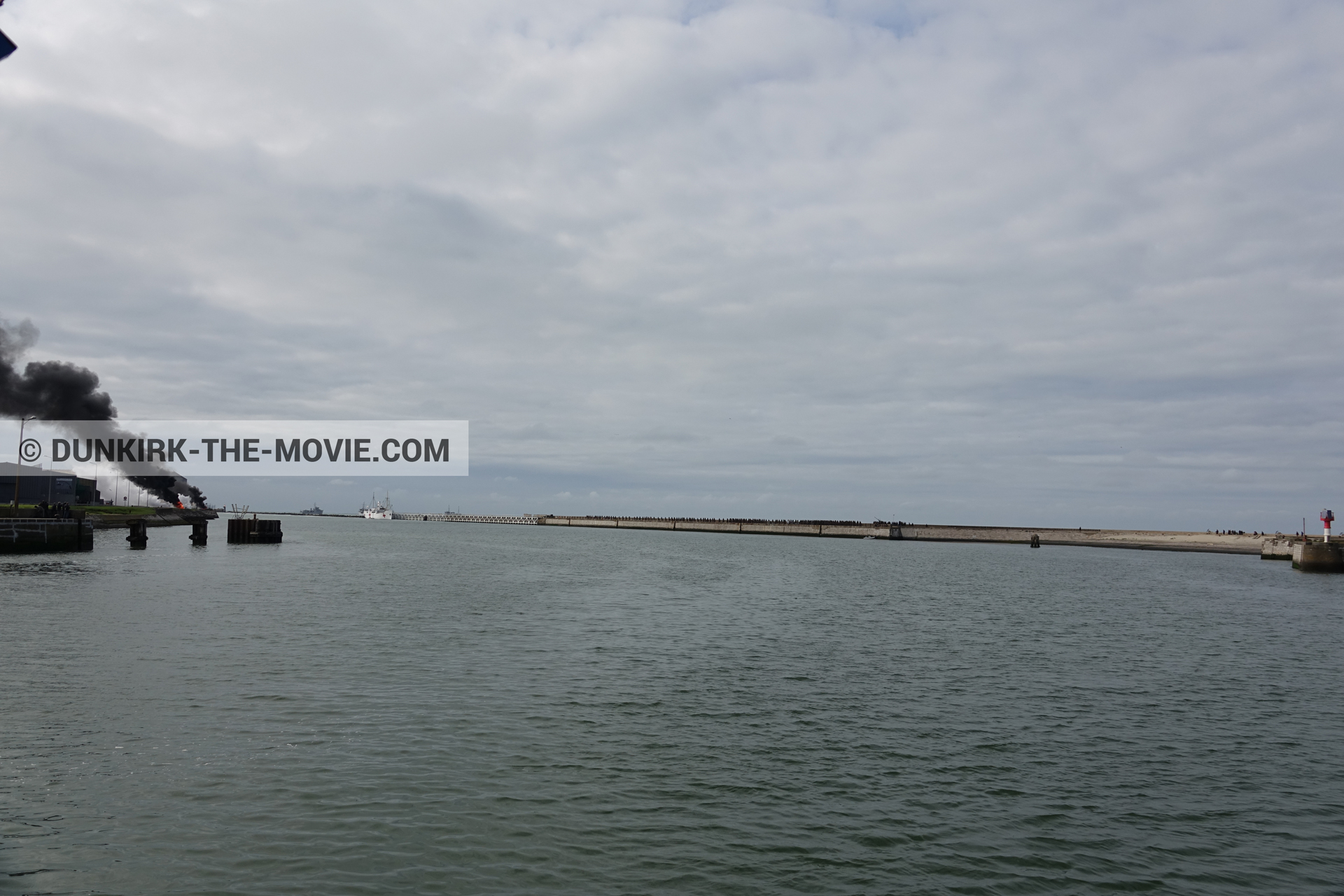 Picture with black smoke, EST pier, calm sea,  from behind the scene of the Dunkirk movie by Nolan