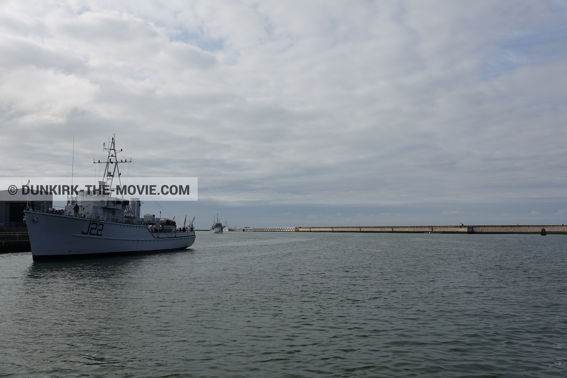 Picture with cloudy sky, J22 -Hr.Ms. Naaldwijk, EST pier, calm sea,  from behind the scene of the Dunkirk movie by Nolan