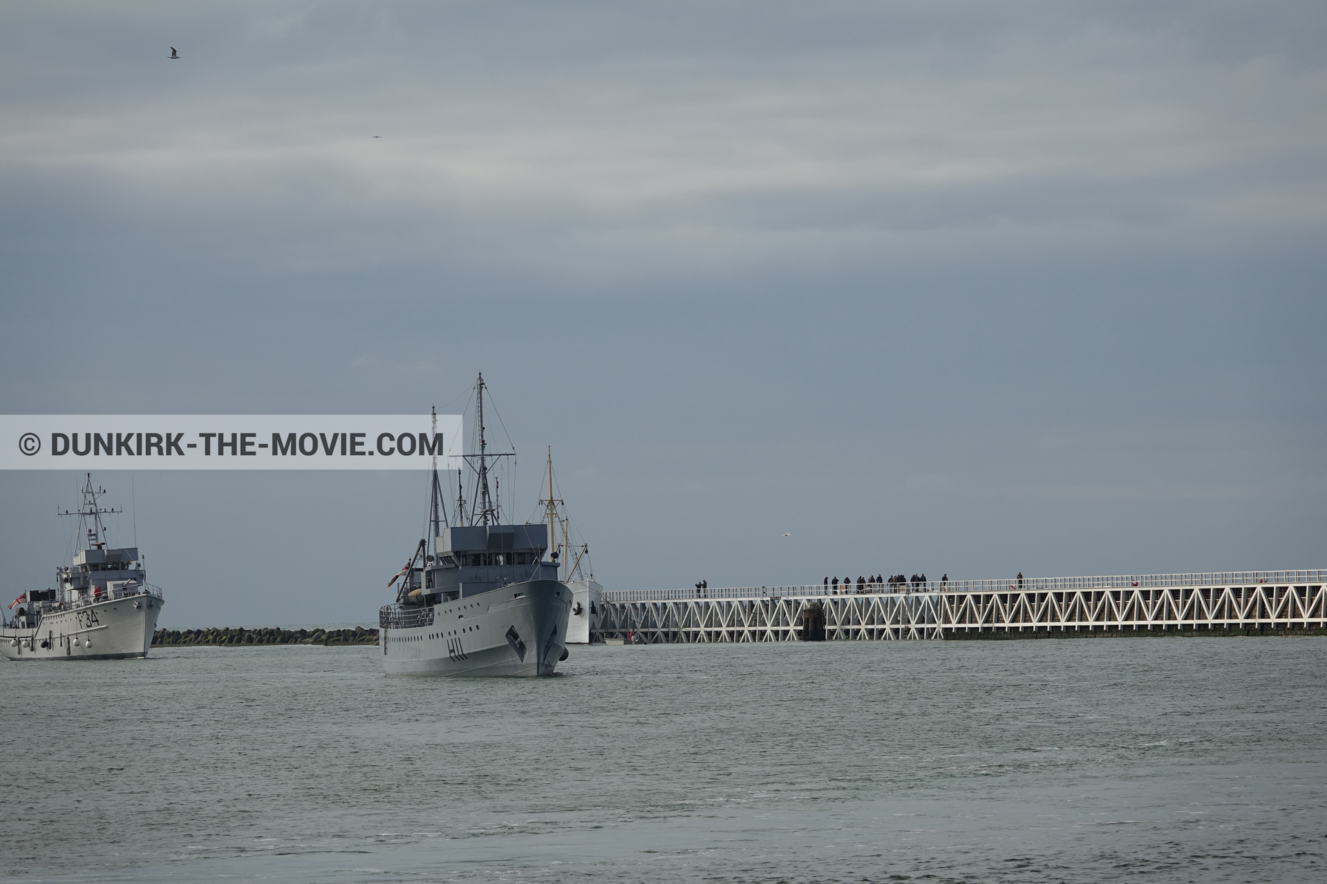 Picture with cloudy sky, F34 - Hr.Ms. Sittard, H11 - MLV Castor, EST pier, calm sea,  from behind the scene of the Dunkirk movie by Nolan