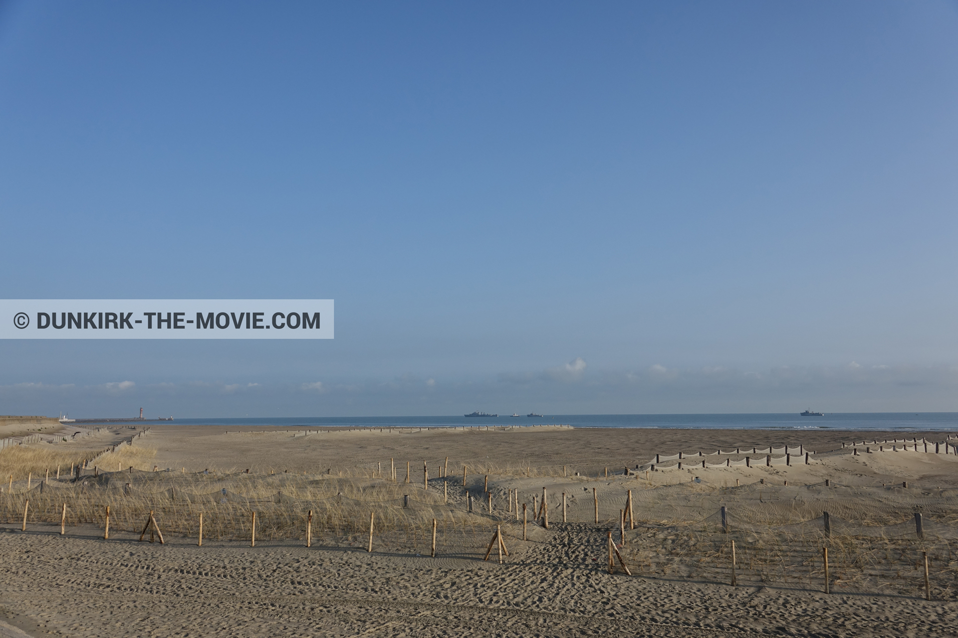 Picture with boat, blue sky, beach,  from behind the scene of the Dunkirk movie by Nolan