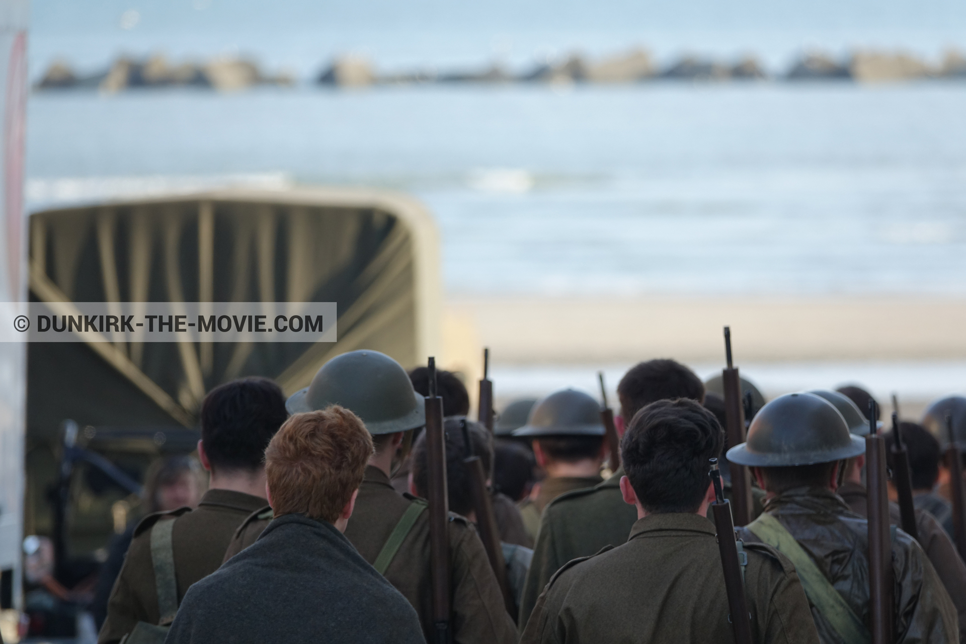 Picture with truck, supernumeraries, beach,  from behind the scene of the Dunkirk movie by Nolan