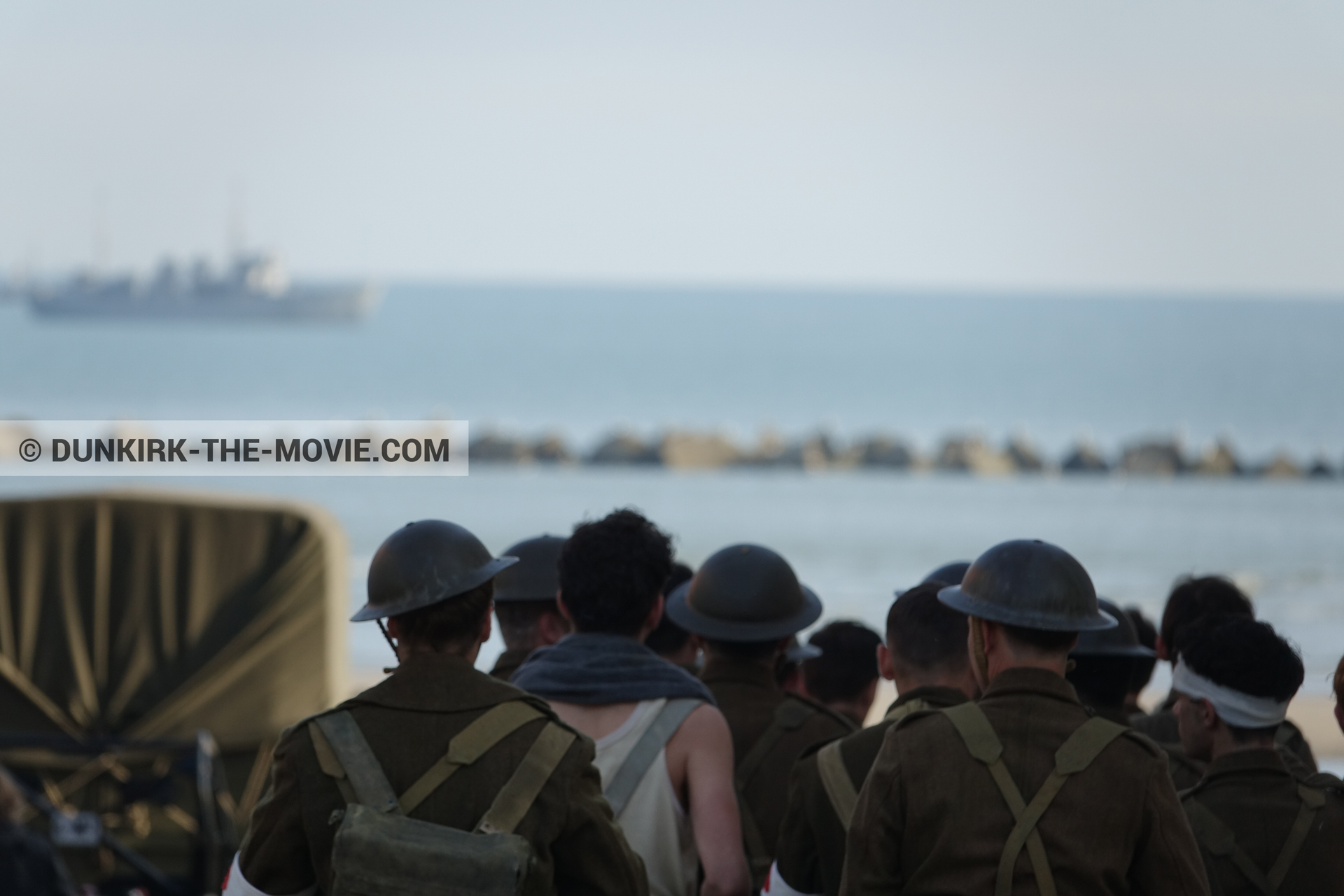 Picture with boat, truck, supernumeraries,  from behind the scene of the Dunkirk movie by Nolan