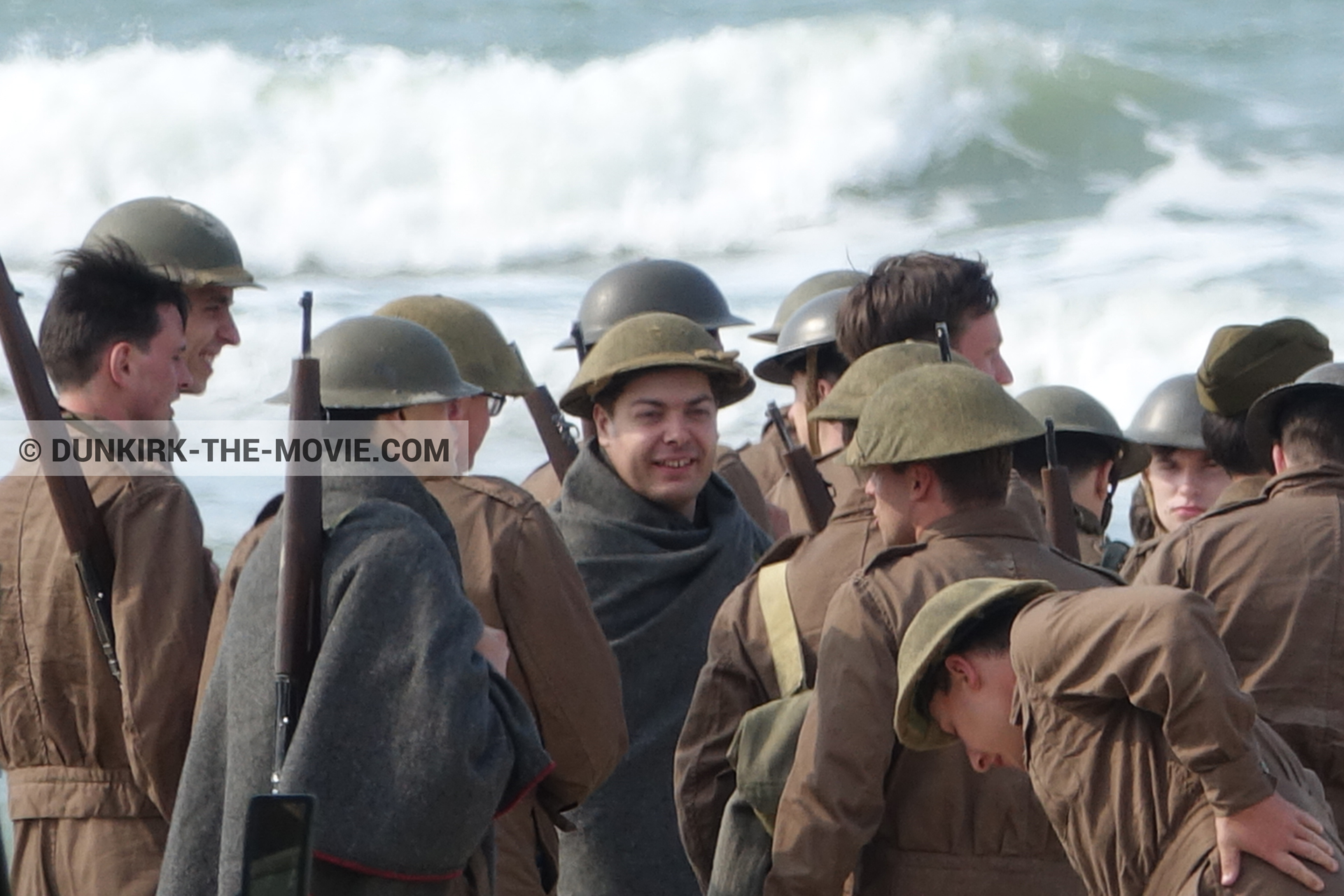 Picture with supernumeraries, rough sea,  from behind the scene of the Dunkirk movie by Nolan