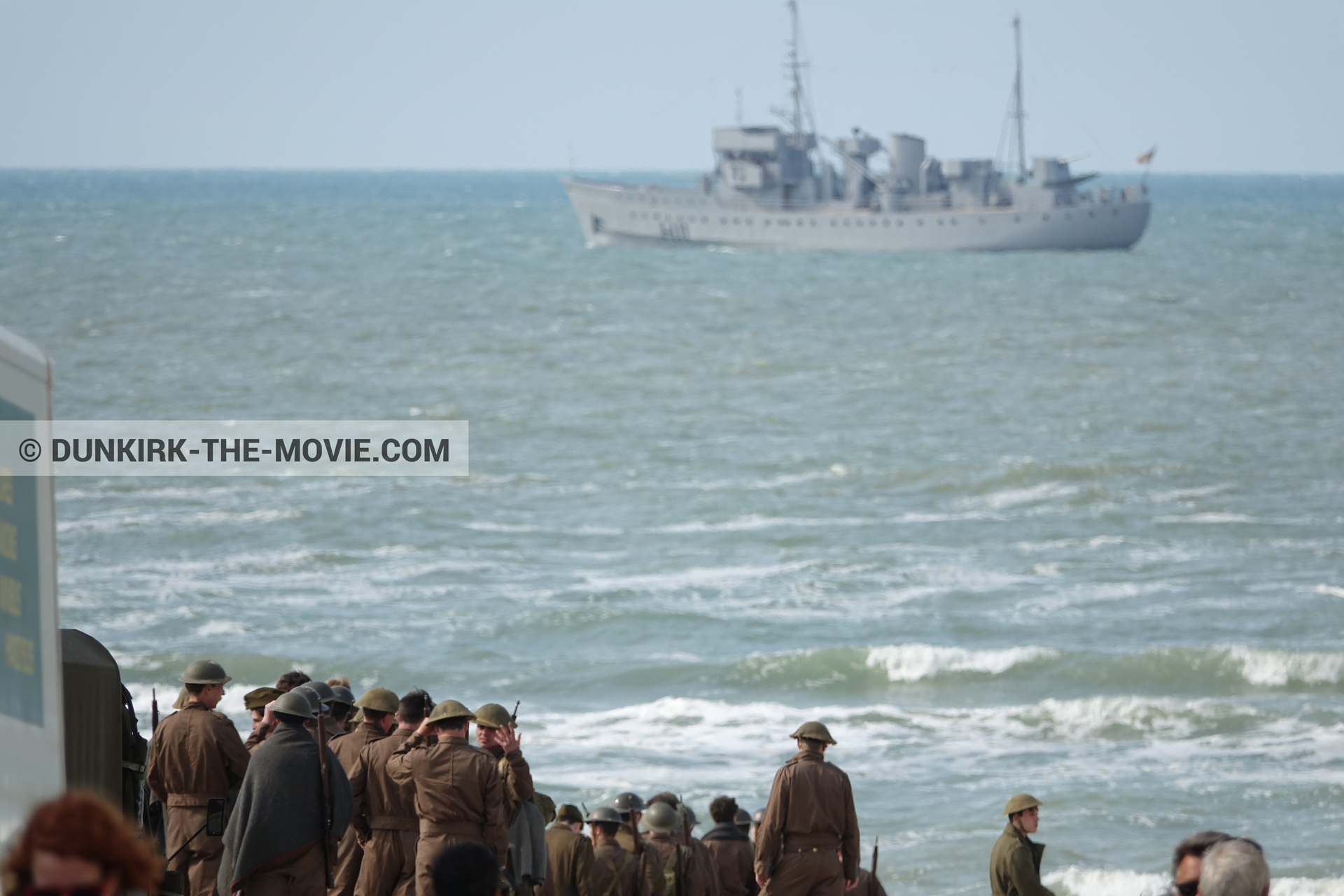 Picture with boat, supernumeraries, rough sea,  from behind the scene of the Dunkirk movie by Nolan