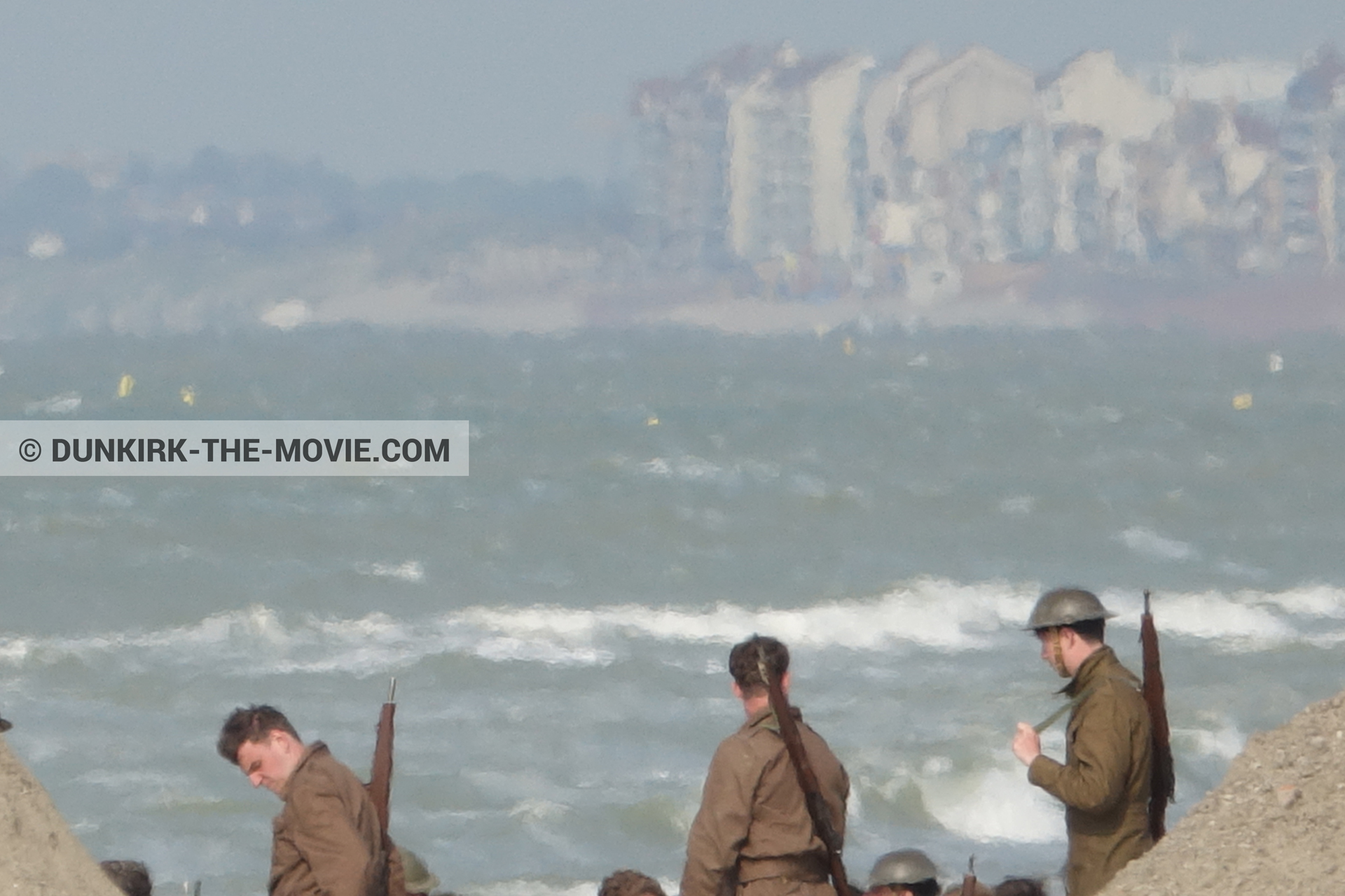 Picture with supernumeraries, rough sea, beach,  from behind the scene of the Dunkirk movie by Nolan