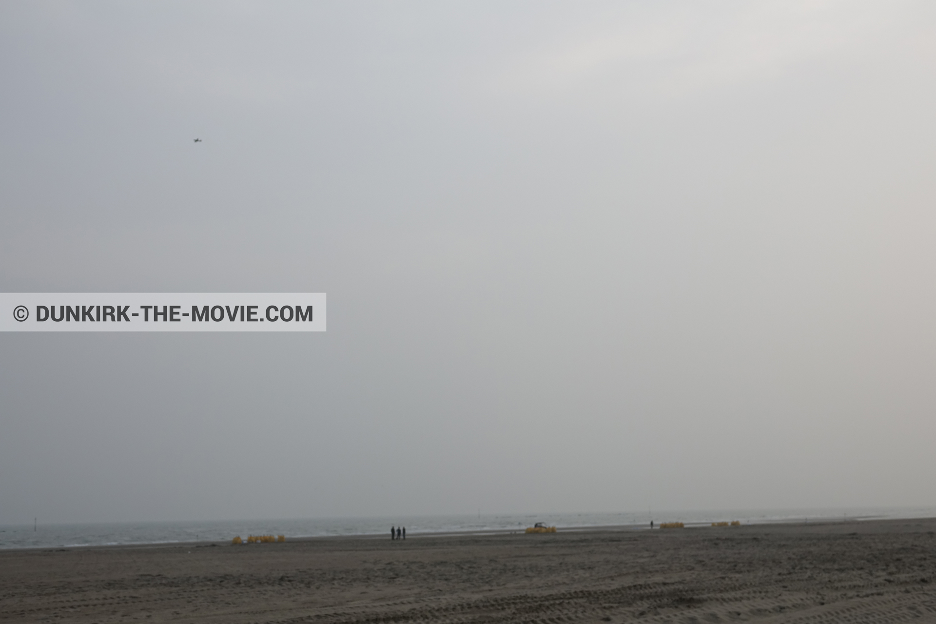 Picture with plane, grey sky, beach,  from behind the scene of the Dunkirk movie by Nolan