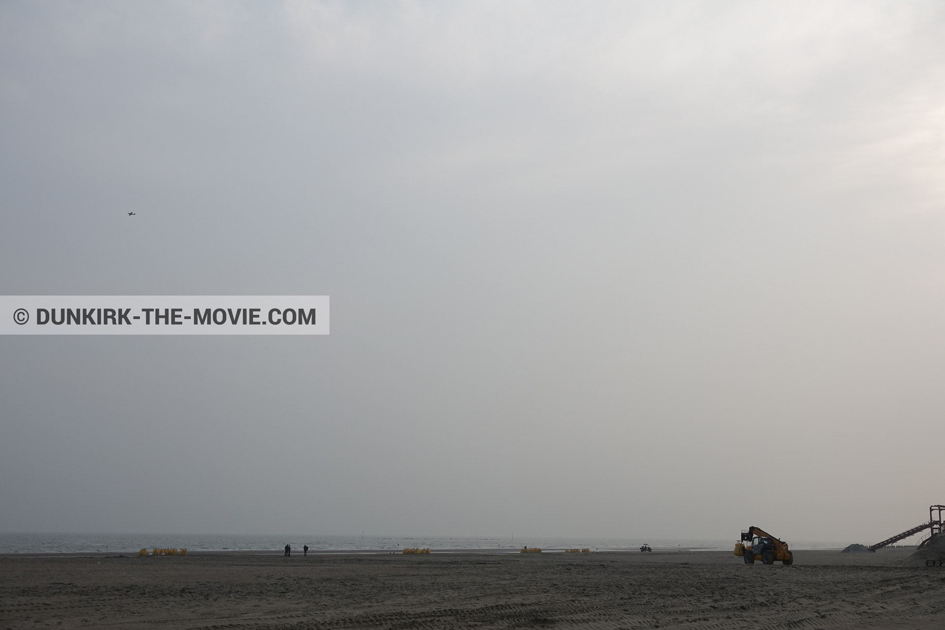Picture with plane, grey sky, decor, beach,  from behind the scene of the Dunkirk movie by Nolan