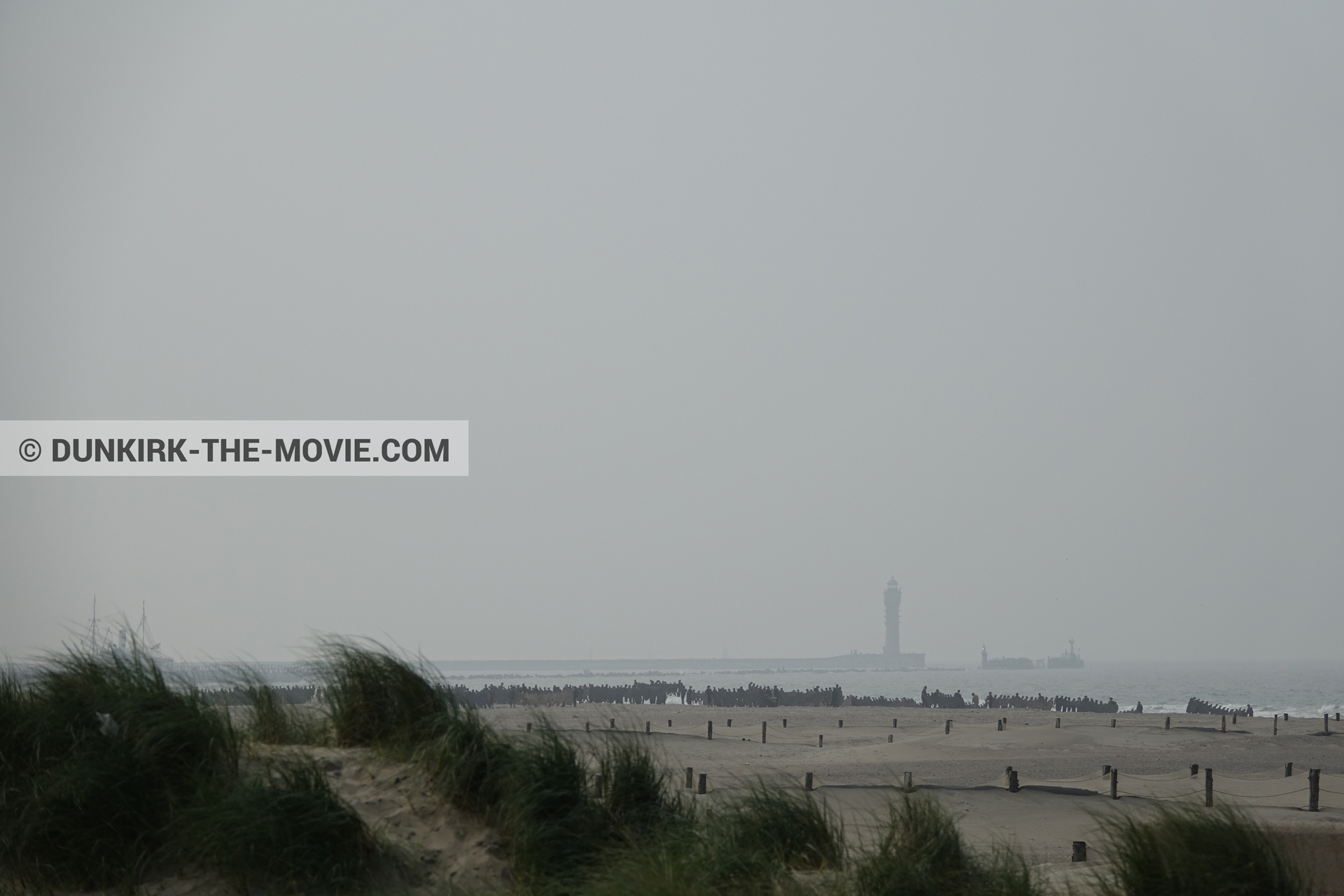 Picture with grey sky, St Pol sur Mer lighthouse, beach,  from behind the scene of the Dunkirk movie by Nolan