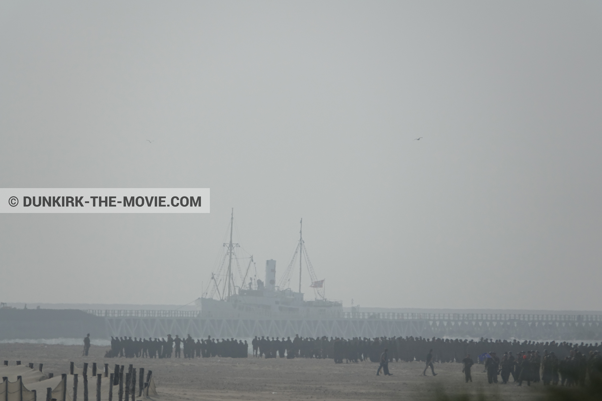 Picture with boat, supernumeraries, beach,  from behind the scene of the Dunkirk movie by Nolan