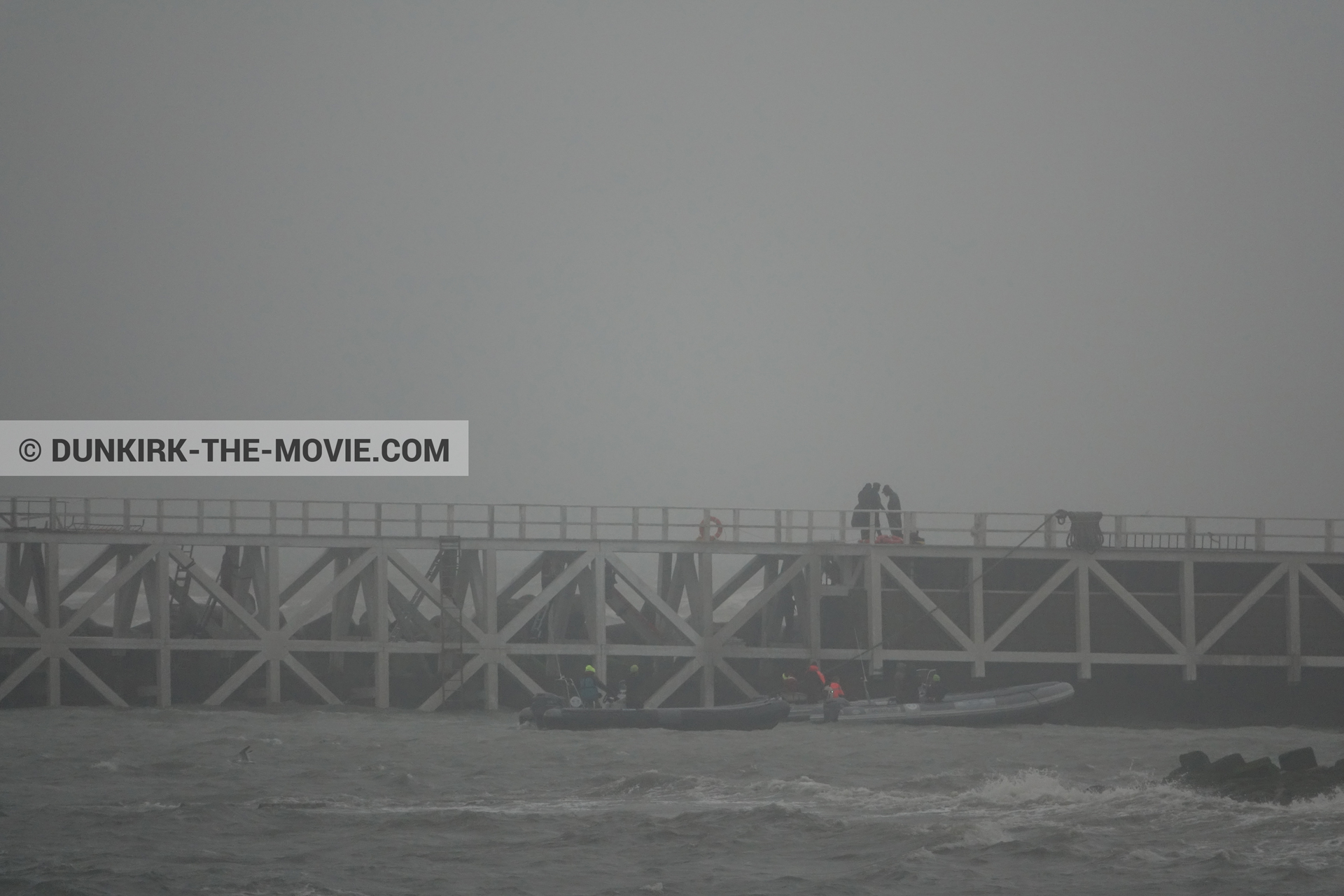Picture with grey sky, EST pier, rough sea, inflatable dinghy,  from behind the scene of the Dunkirk movie by Nolan