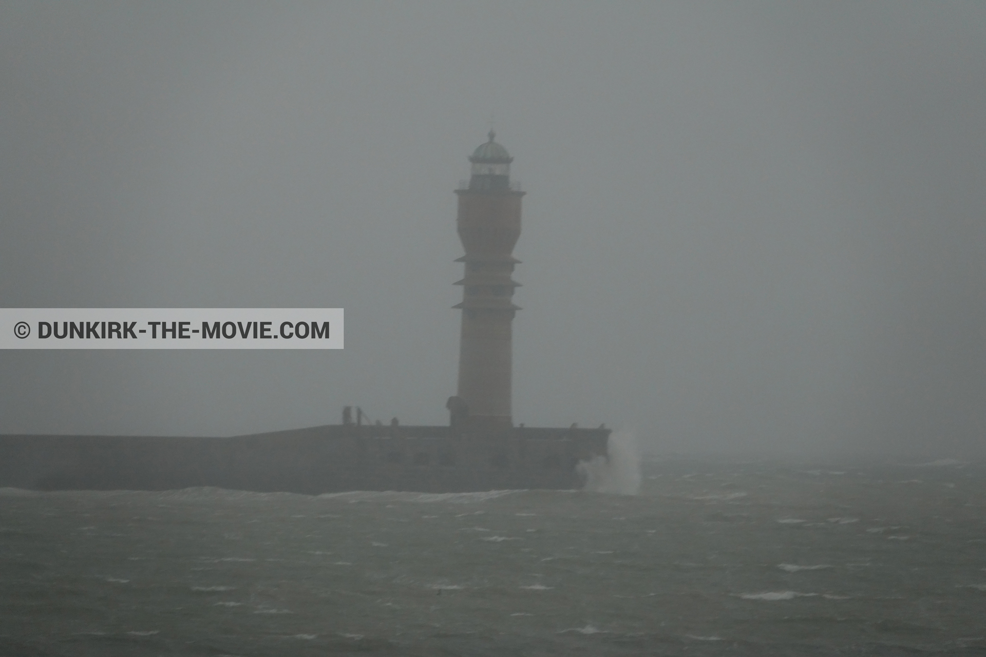 Picture with grey sky, rough sea, St Pol sur Mer lighthouse,  from behind the scene of the Dunkirk movie by Nolan