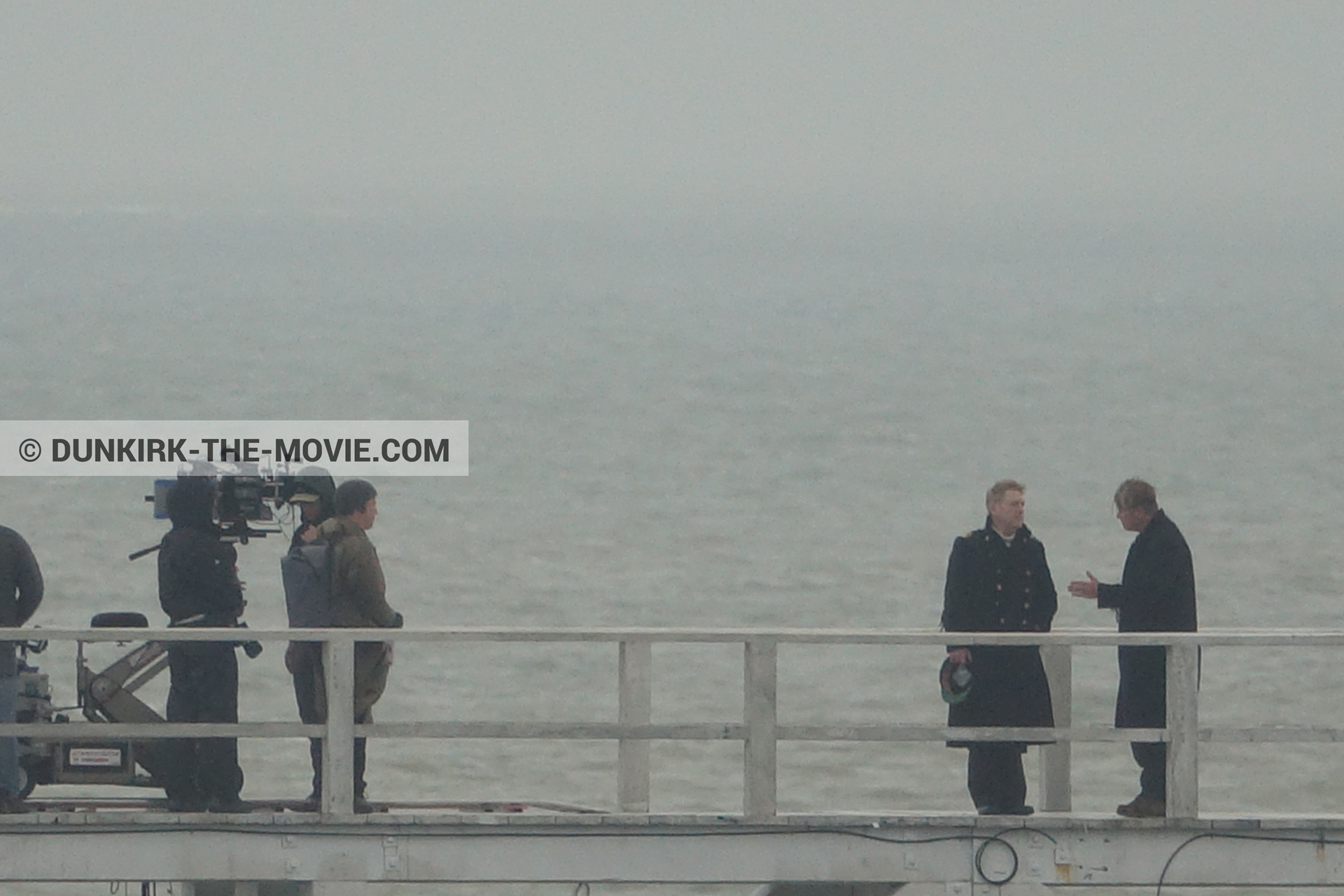 Picture with grey sky, EST pier, Kenneth Branagh, Christopher Nolan, technical team,  from behind the scene of the Dunkirk movie by Nolan