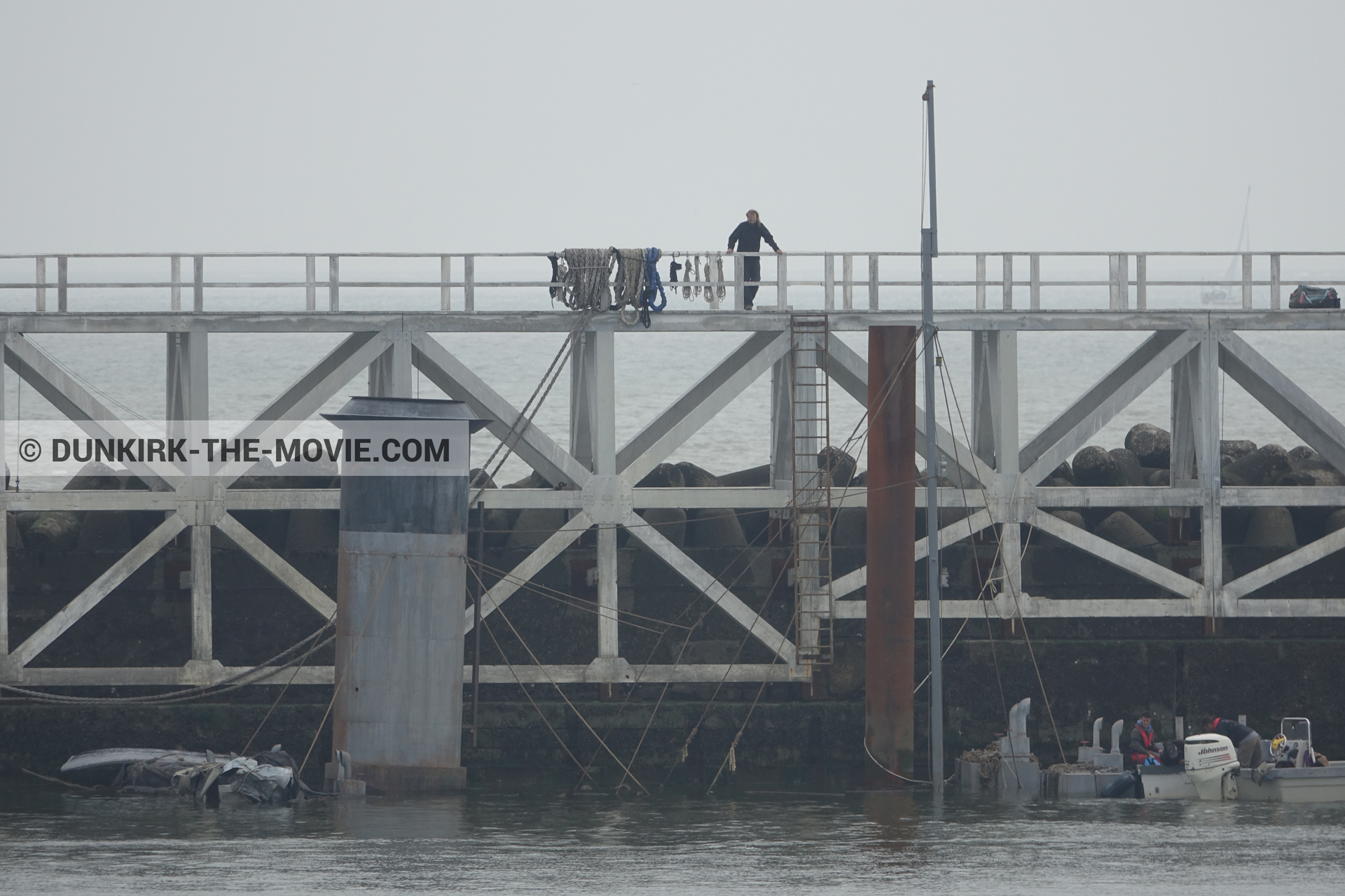 Picture with grey sky, decor, EST pier, calm sea,  from behind the scene of the Dunkirk movie by Nolan