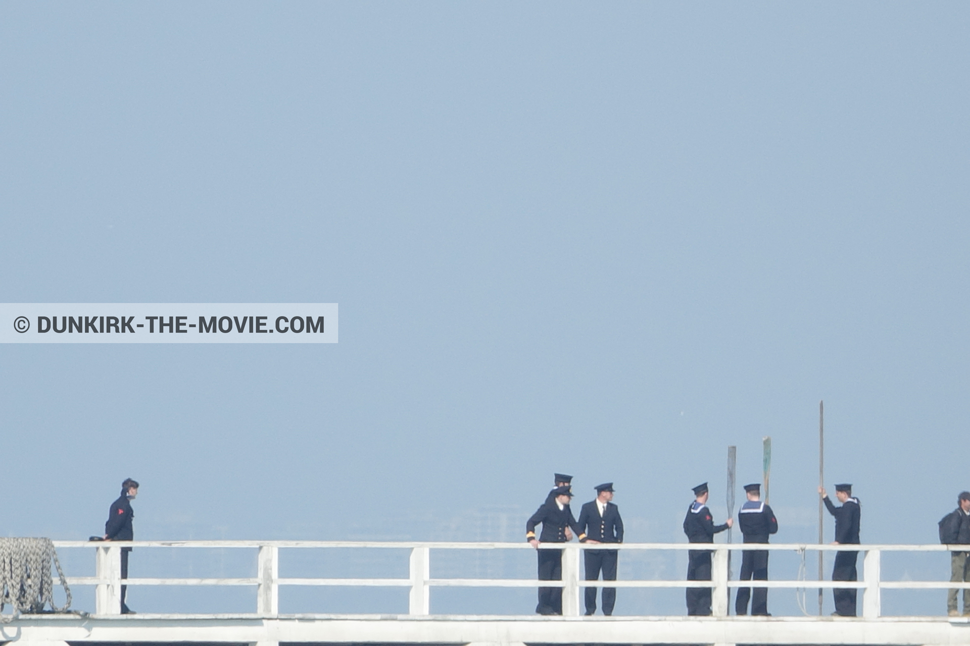 Picture with blue sky, supernumeraries, EST pier, technical team,  from behind the scene of the Dunkirk movie by Nolan