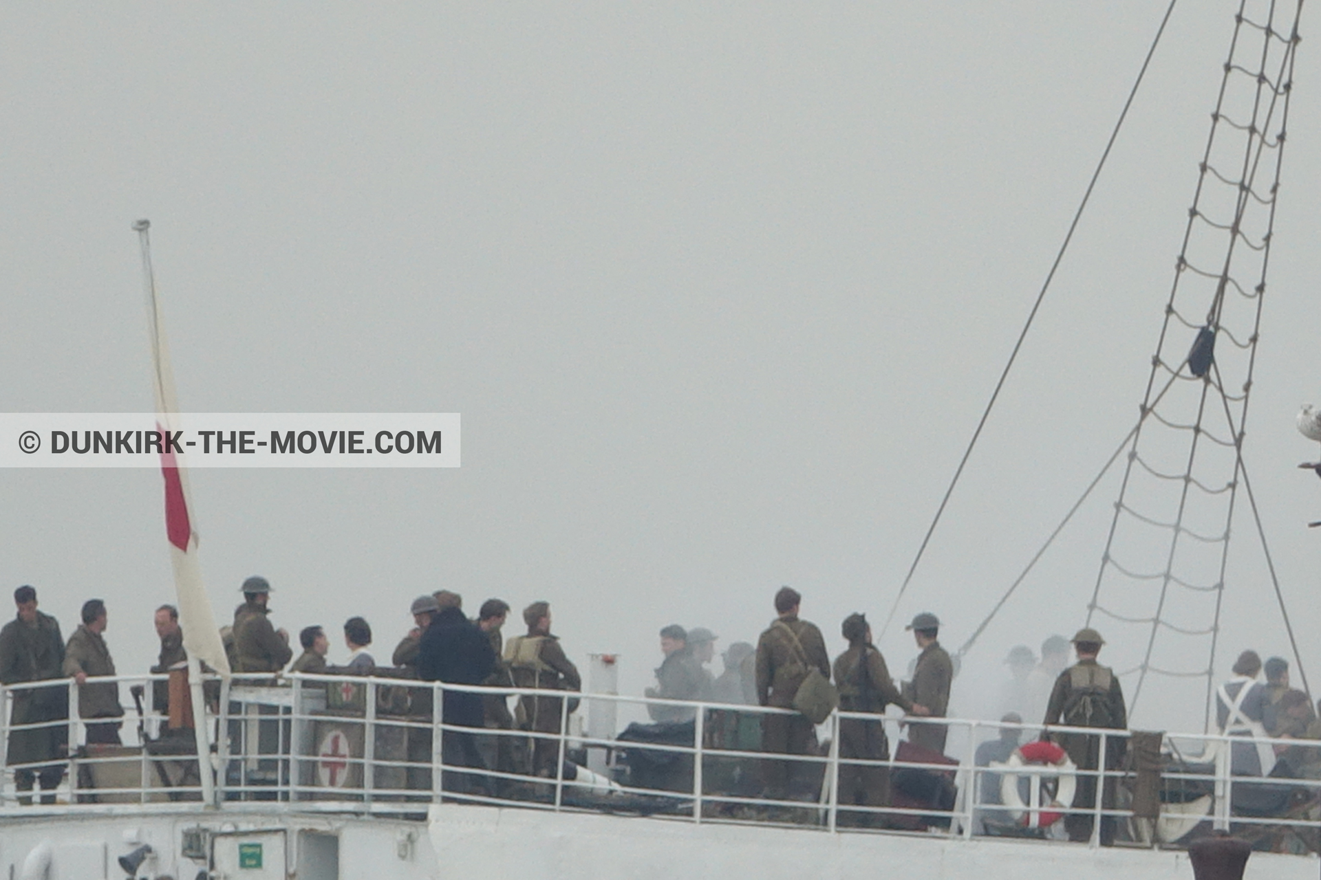 Picture with grey sky, supernumeraries, white smoke, EST pier, technical team, M/S Rogaland,  from behind the scene of the Dunkirk movie by Nolan