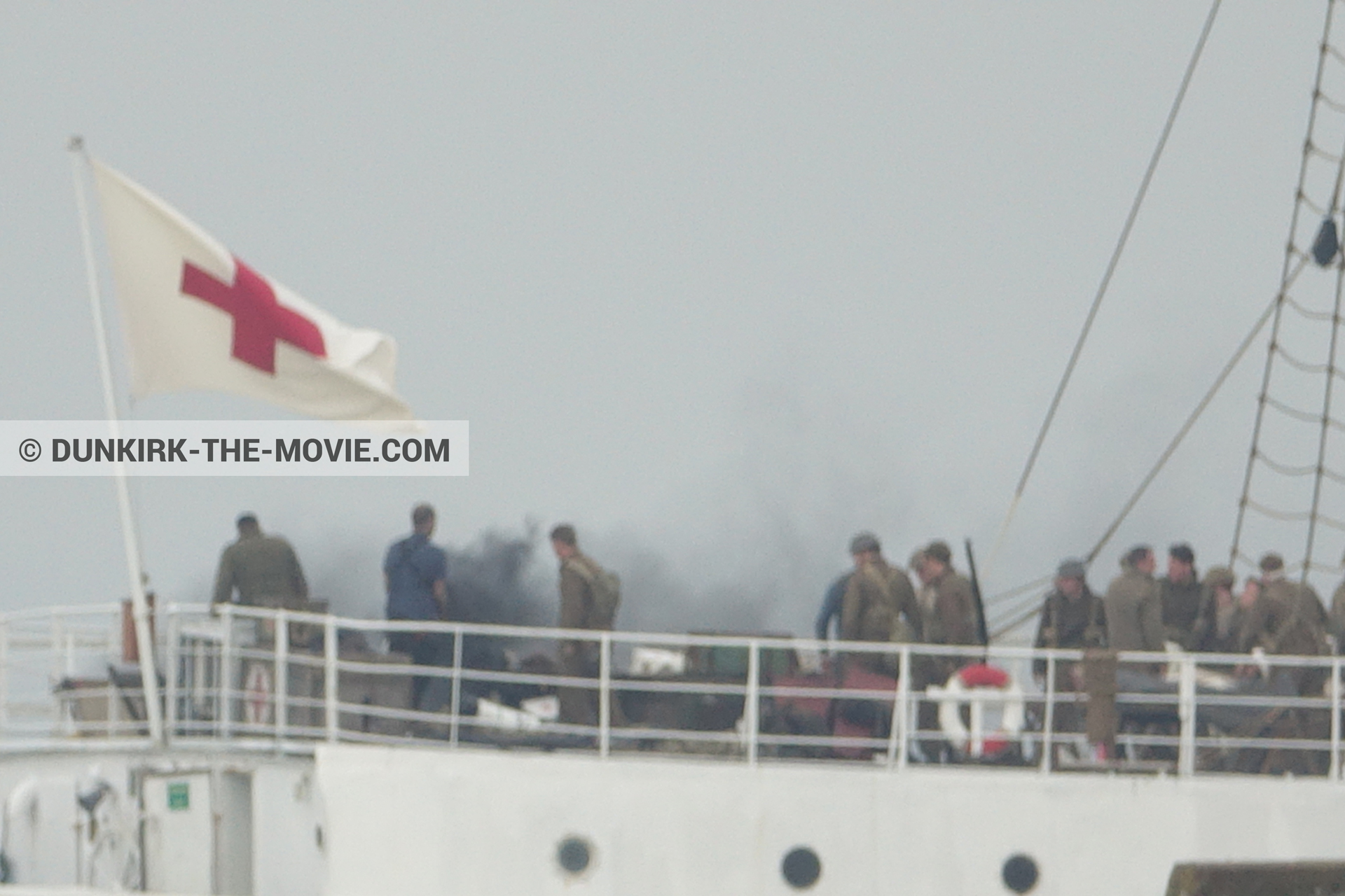 Picture with grey sky, supernumeraries, black smoke, EST pier, technical team, M/S Rogaland,  from behind the scene of the Dunkirk movie by Nolan