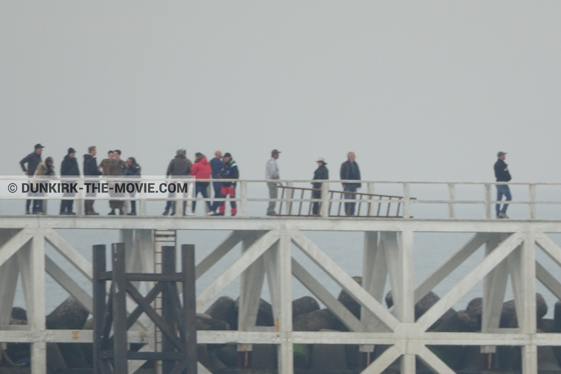 Picture with actor, grey sky, Hoyte van Hoytema, EST pier, Christopher Nolan, technical team, Nilo Otero,  from behind the scene of the Dunkirk movie by Nolan