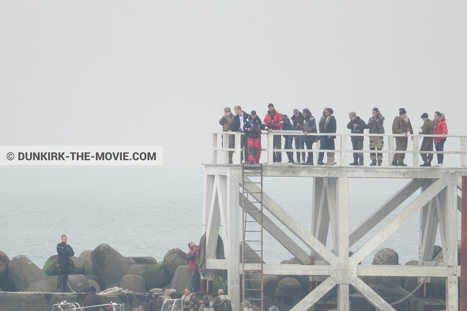 Picture with actor, grey sky, supernumeraries, Hoyte van Hoytema, EST pier, Christopher Nolan, inflatable dinghy,  from behind the scene of the Dunkirk movie by Nolan