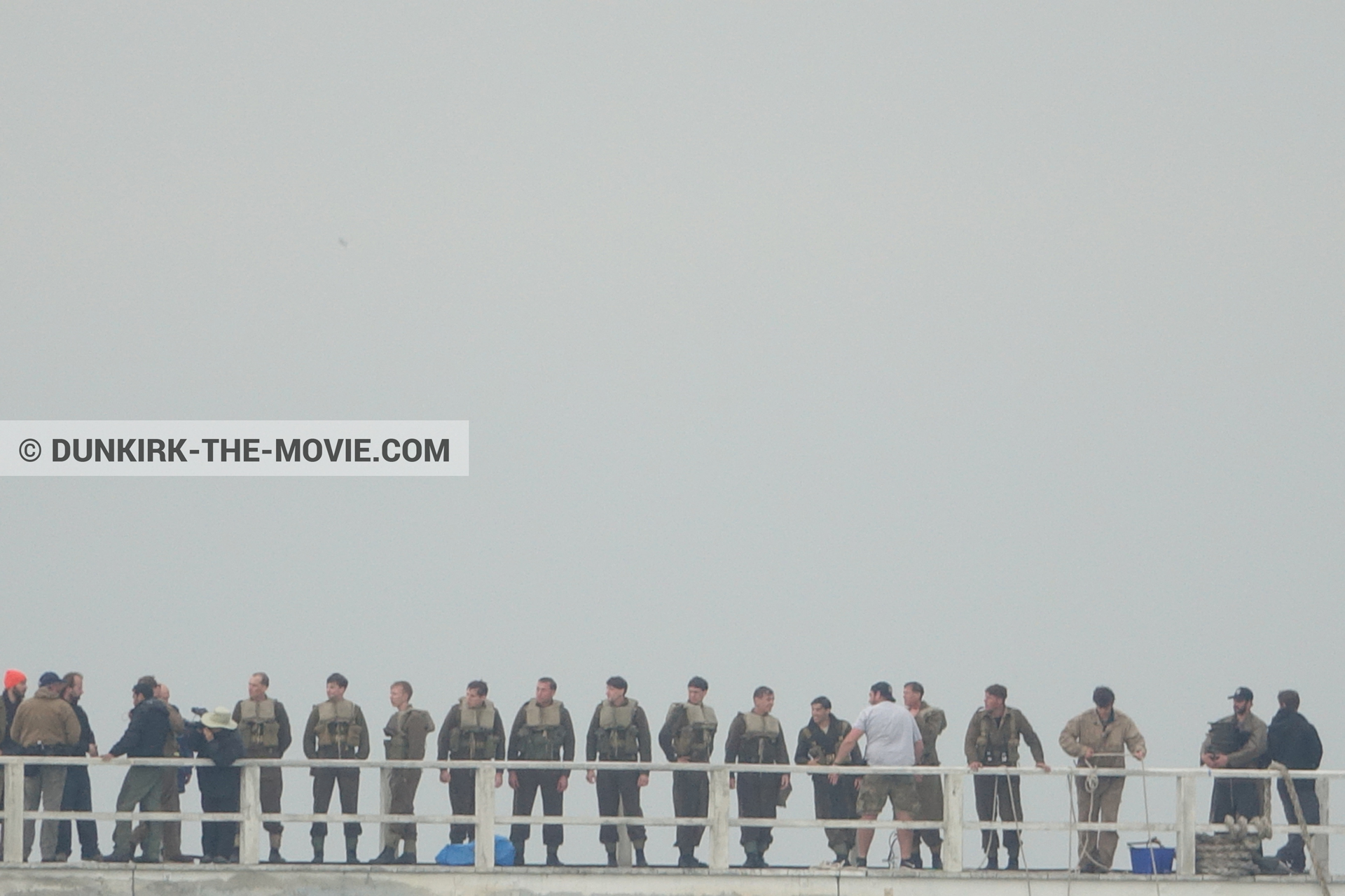 Picture with grey sky, supernumeraries, EST pier, technical team,  from behind the scene of the Dunkirk movie by Nolan