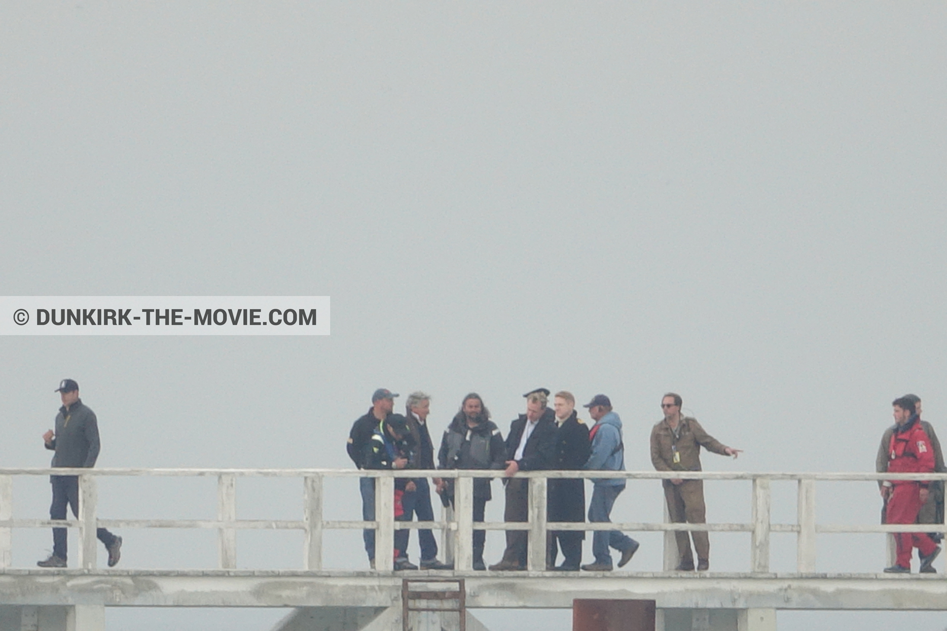 Picture with grey sky, supernumeraries, Hoyte van Hoytema, EST pier, Kenneth Branagh, Christopher Nolan, technical team, Nilo Otero,  from behind the scene of the Dunkirk movie by Nolan