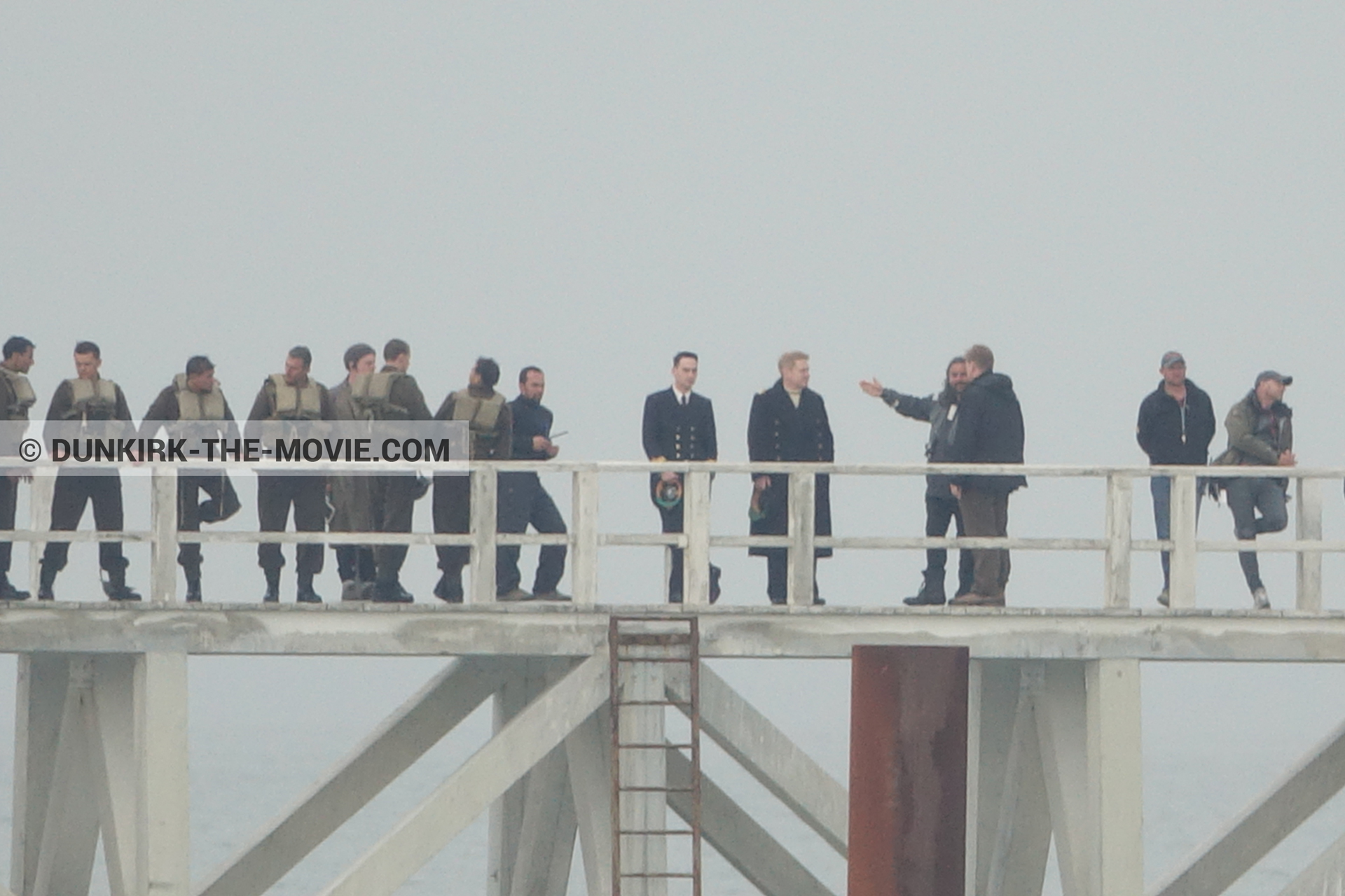 Picture with actor, grey sky, supernumeraries, Hoyte van Hoytema, EST pier, Kenneth Branagh, Christopher Nolan, technical team,  from behind the scene of the Dunkirk movie by Nolan