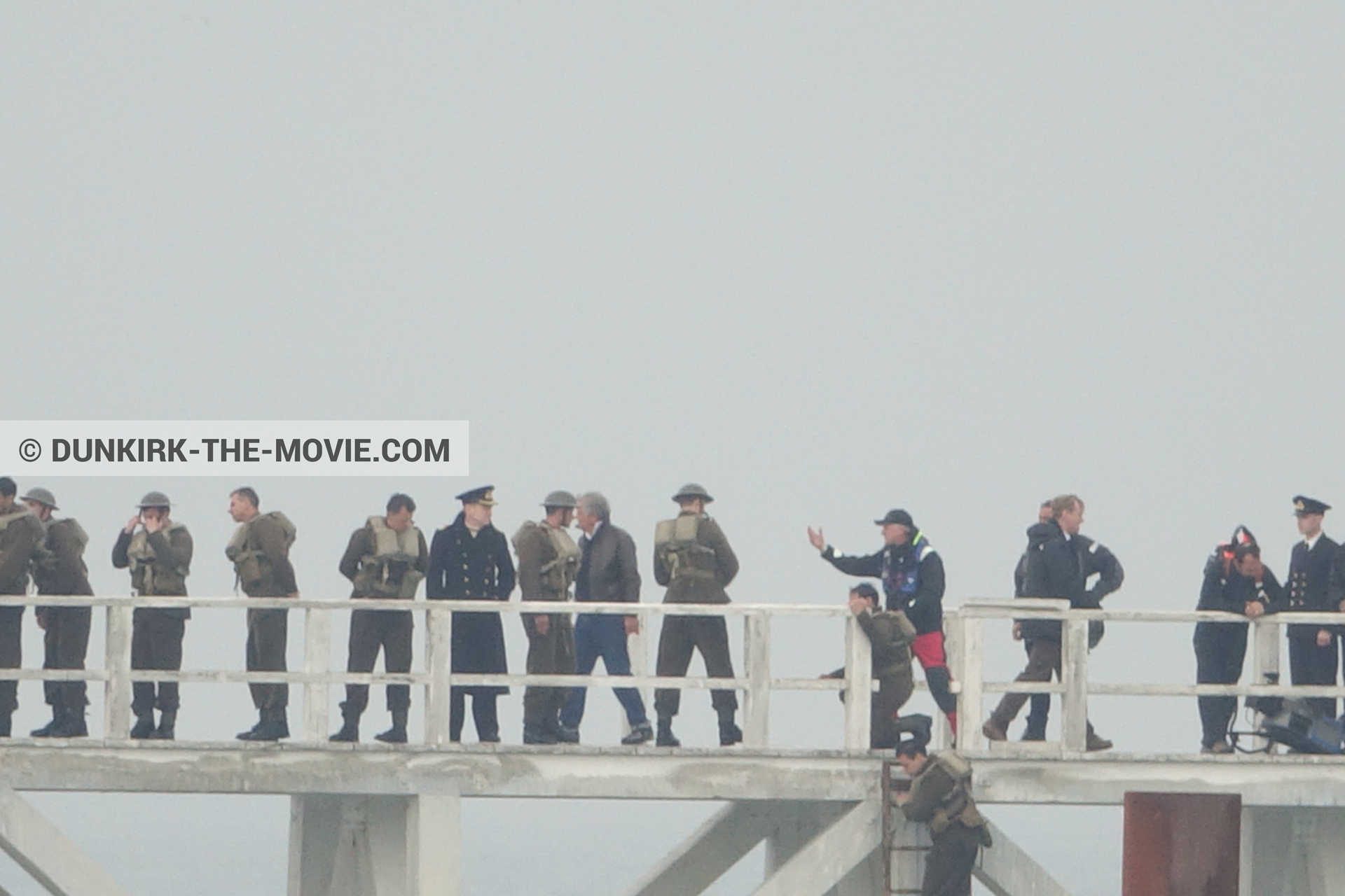 Picture with actor, grey sky, supernumeraries, Hoyte van Hoytema, EST pier, Kenneth Branagh, Christopher Nolan, technical team, Nilo Otero,  from behind the scene of the Dunkirk movie by Nolan