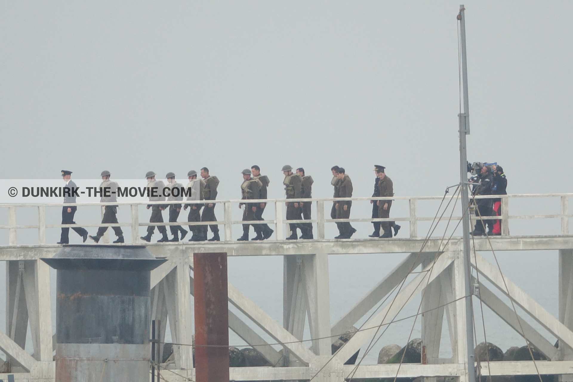 Picture with actor, IMAX camera, grey sky, decor, supernumeraries, Hoyte van Hoytema, EST pier,  from behind the scene of the Dunkirk movie by Nolan