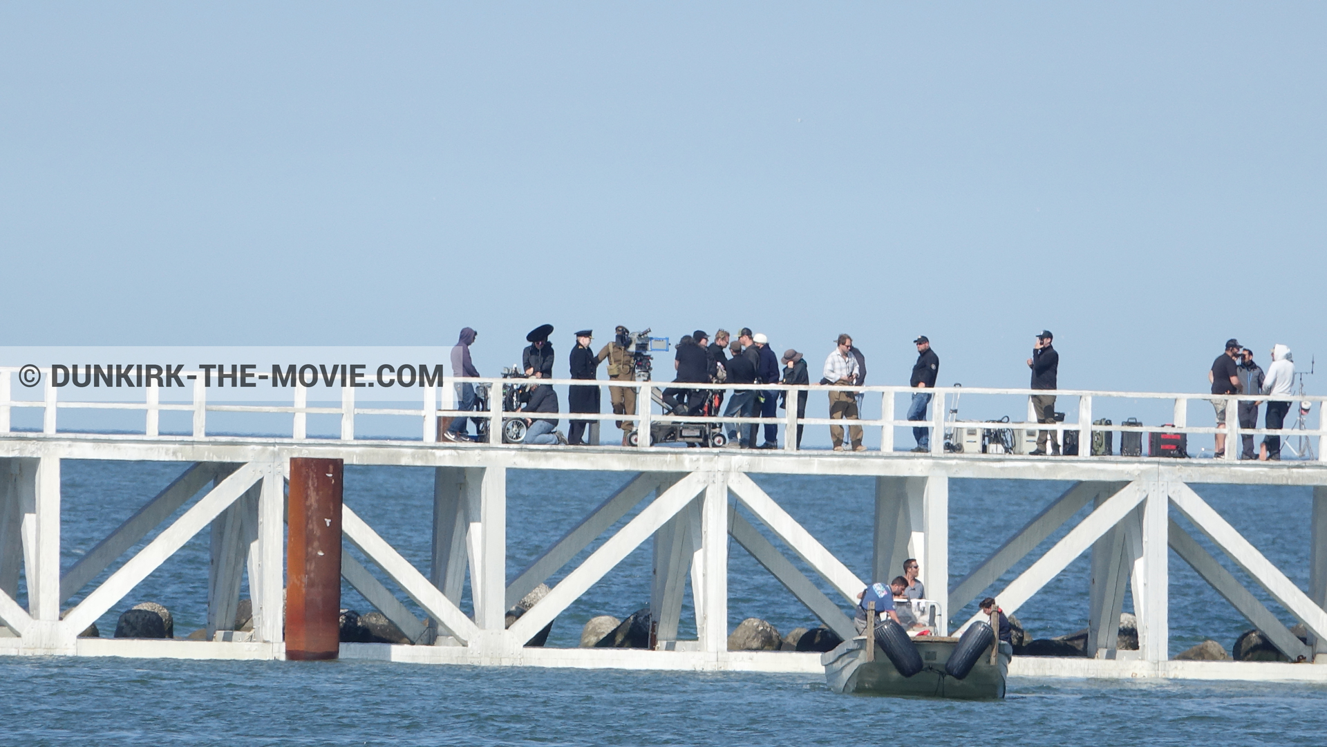 Picture with actor, IMAX camera, blue sky, EST pier, Kenneth Branagh, Christopher Nolan, technical team, inflatable dinghy,  from behind the scene of the Dunkirk movie by Nolan