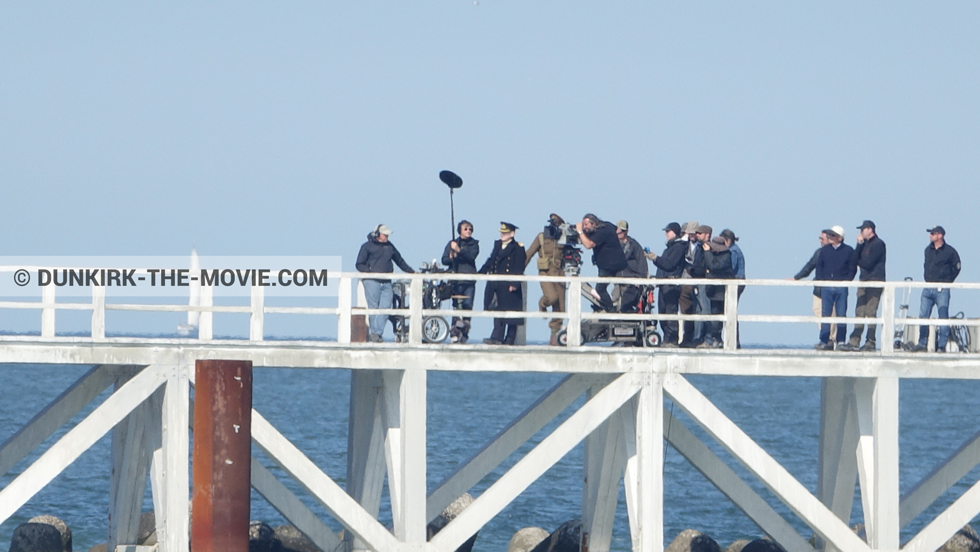 Picture with actor, IMAX camera, Hoyte van Hoytema, EST pier, Kenneth Branagh, technical team,  from behind the scene of the Dunkirk movie by Nolan
