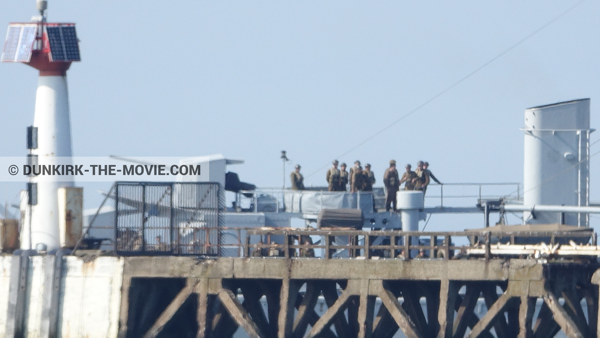 Picture with blue sky, supernumeraries,  from behind the scene of the Dunkirk movie by Nolan