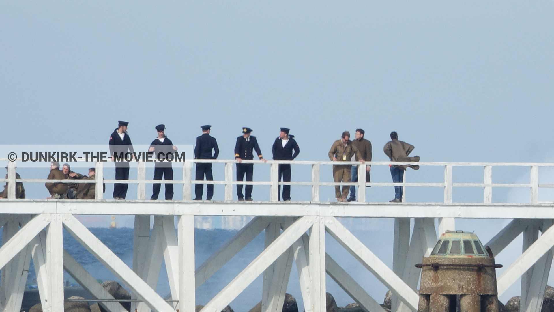 Picture with blue sky, supernumeraries, white smoke, EST pier, technical team,  from behind the scene of the Dunkirk movie by Nolan