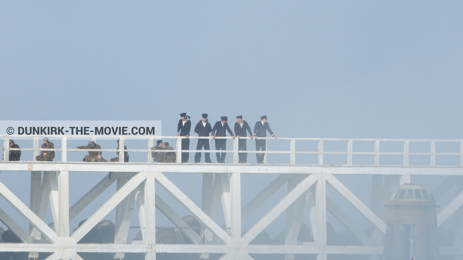 Picture with blue sky, supernumeraries, white smoke, EST pier,  from behind the scene of the Dunkirk movie by Nolan