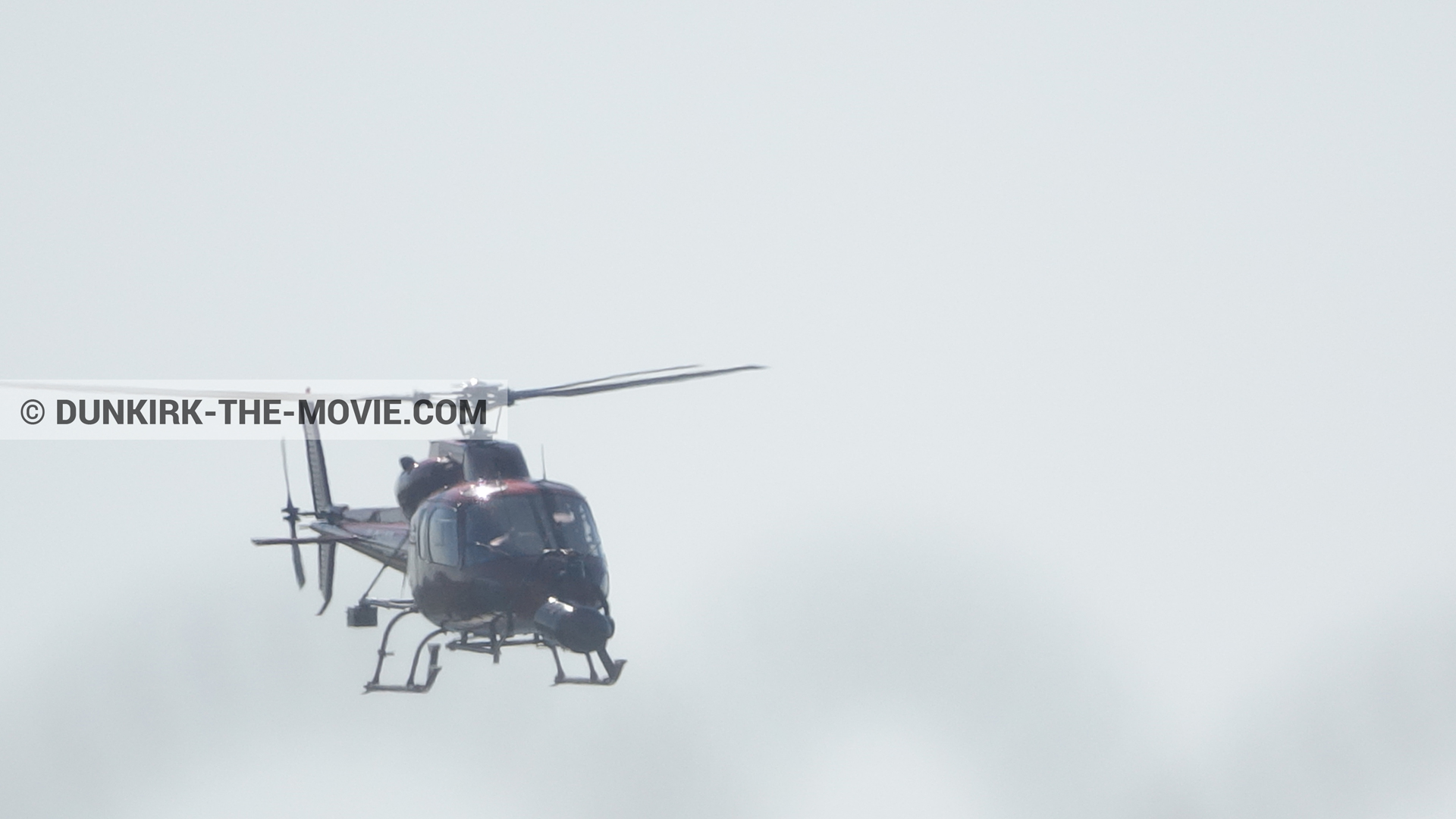 Picture with grey sky, helicopter camera,  from behind the scene of the Dunkirk movie by Nolan