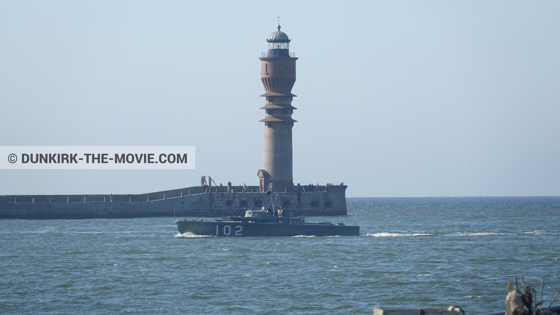 Picture with boat, blue sky, St Pol sur Mer lighthouse,  from behind the scene of the Dunkirk movie by Nolan