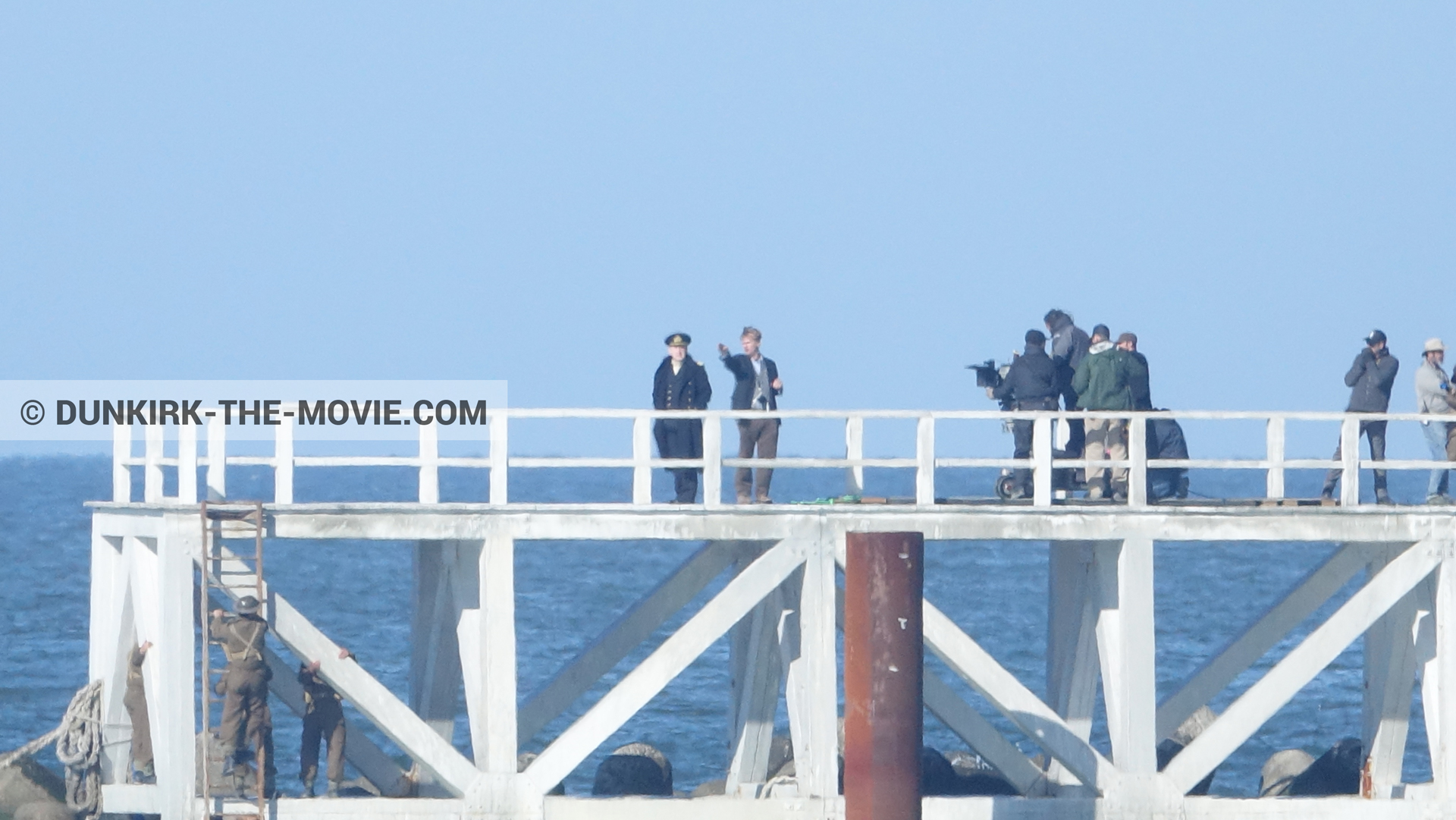 Picture with blue sky, Hoyte van Hoytema, EST pier, Kenneth Branagh, calm sea, Christopher Nolan, technical team,  from behind the scene of the Dunkirk movie by Nolan