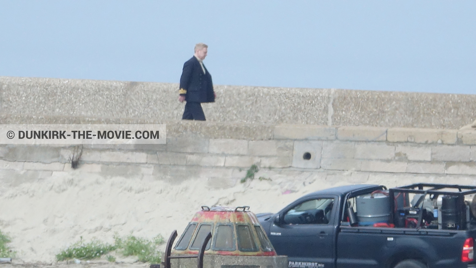 Picture with EST pier, Kenneth Branagh, blue sky,  from behind the scene of the Dunkirk movie by Nolan
