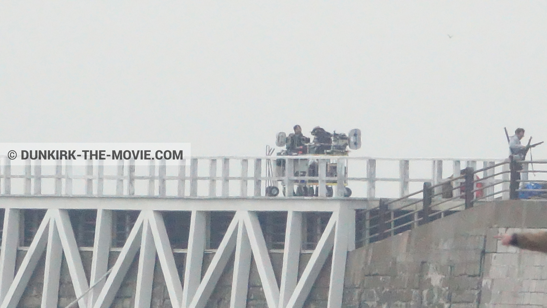 Picture with IMAX camera, grey sky, EST pier, technical team,  from behind the scene of the Dunkirk movie by Nolan