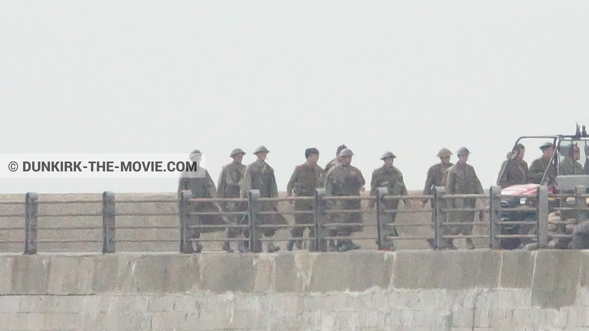 Picture with grey sky, supernumeraries, EST pier,  from behind the scene of the Dunkirk movie by Nolan