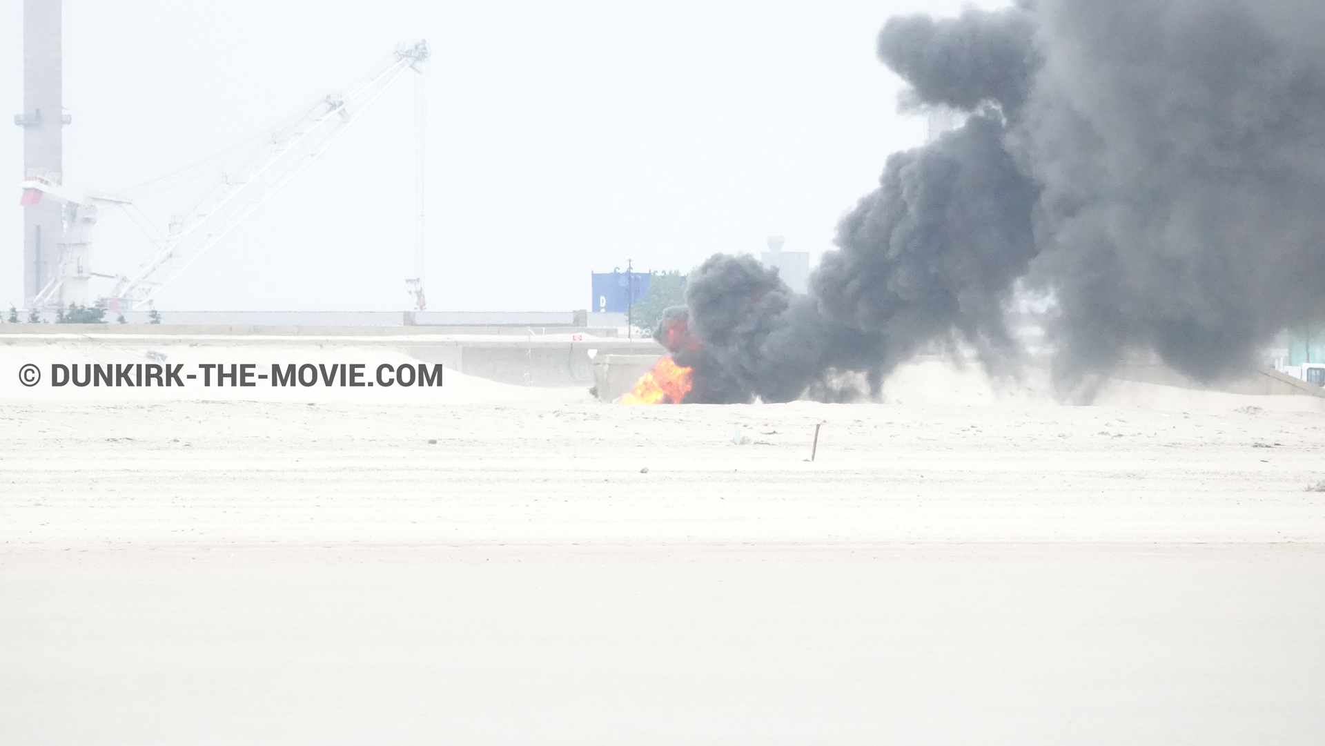 Picture with black smoke, beach,  from behind the scene of the Dunkirk movie by Nolan