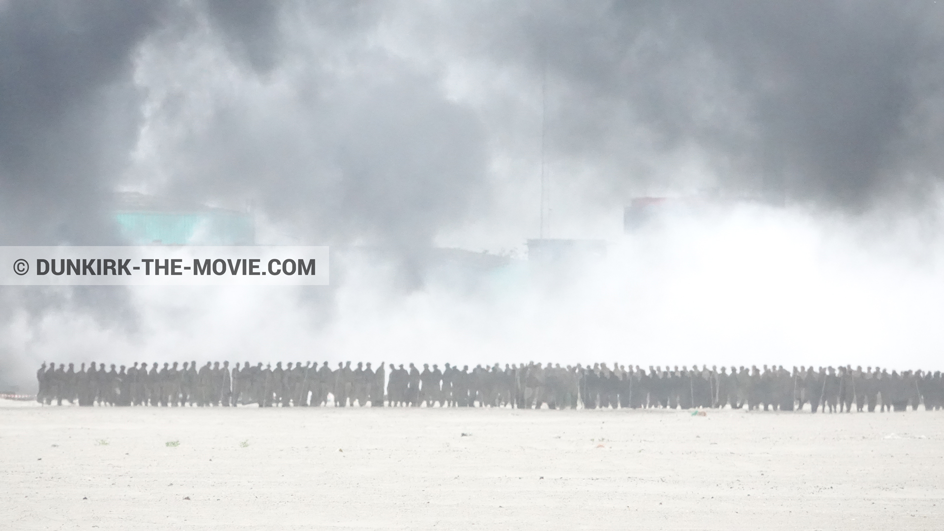 Picture with decor, black smoke, beach,  from behind the scene of the Dunkirk movie by Nolan