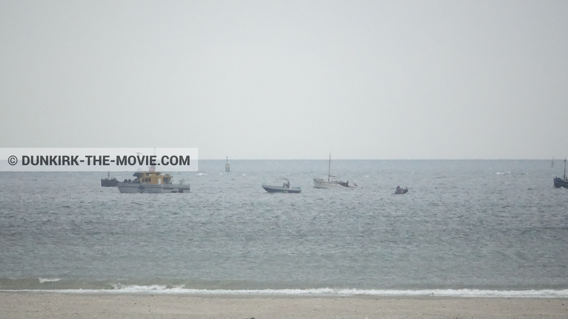 Picture with boat, grey sky, Ocean Wind 4, beach,  from behind the scene of the Dunkirk movie by Nolan