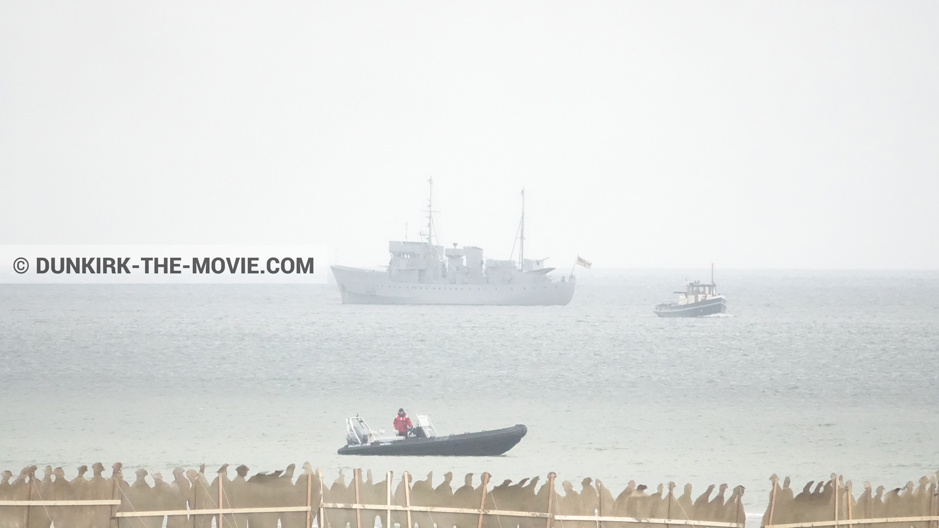 Picture with inflatable dinghy, decor, decor, calm sea, H11 - MLV Castor, technical team, grey sky, boat,  from behind the scene of the Dunkirk movie by Nolan
