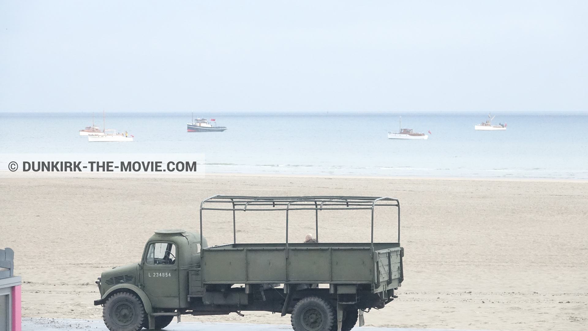 Picture with boat, truck, beach,  from behind the scene of the Dunkirk movie by Nolan