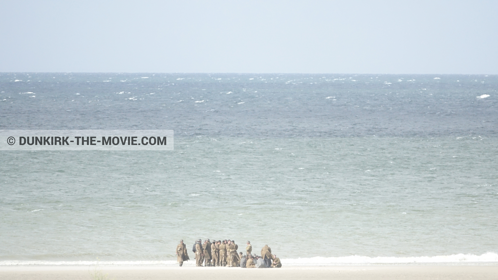 Picture with supernumeraries, beach,  from behind the scene of the Dunkirk movie by Nolan